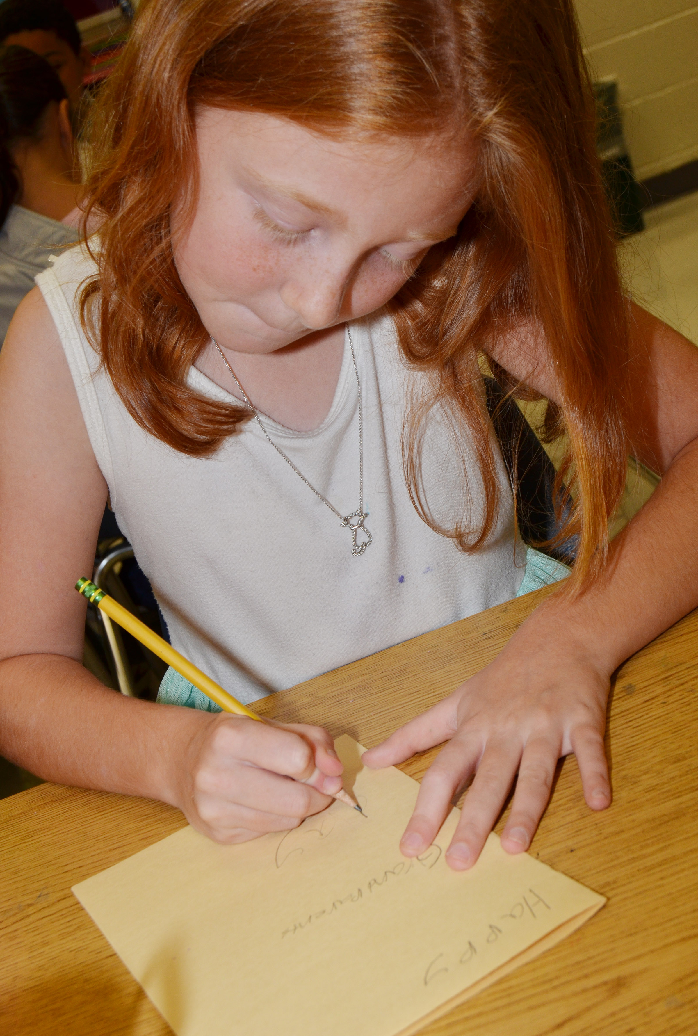 CES fourth-grader Savannah Wethington makes a card for her grandparents.