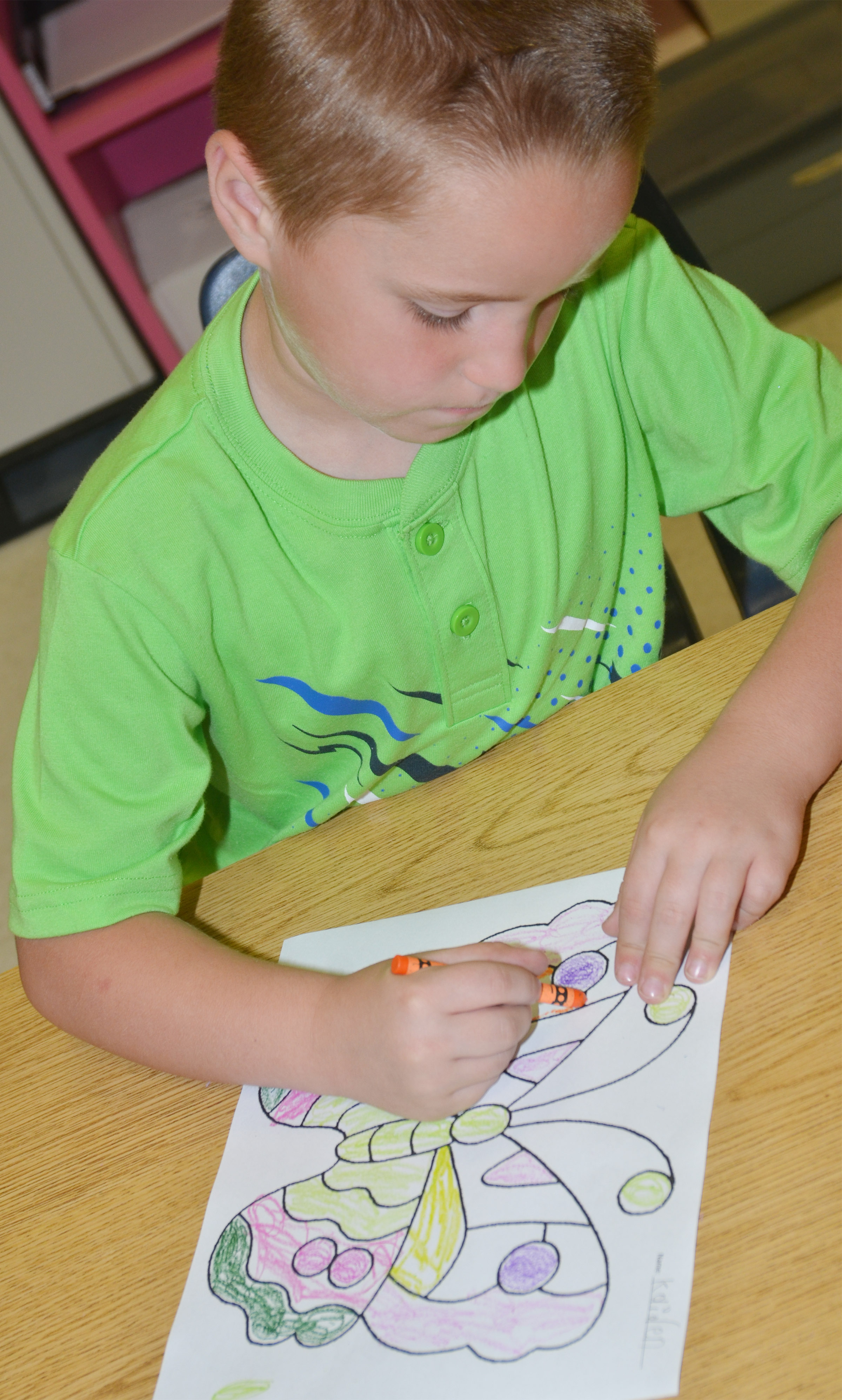 CES kindergartener Kaiden Bradfield colors his butterfly.