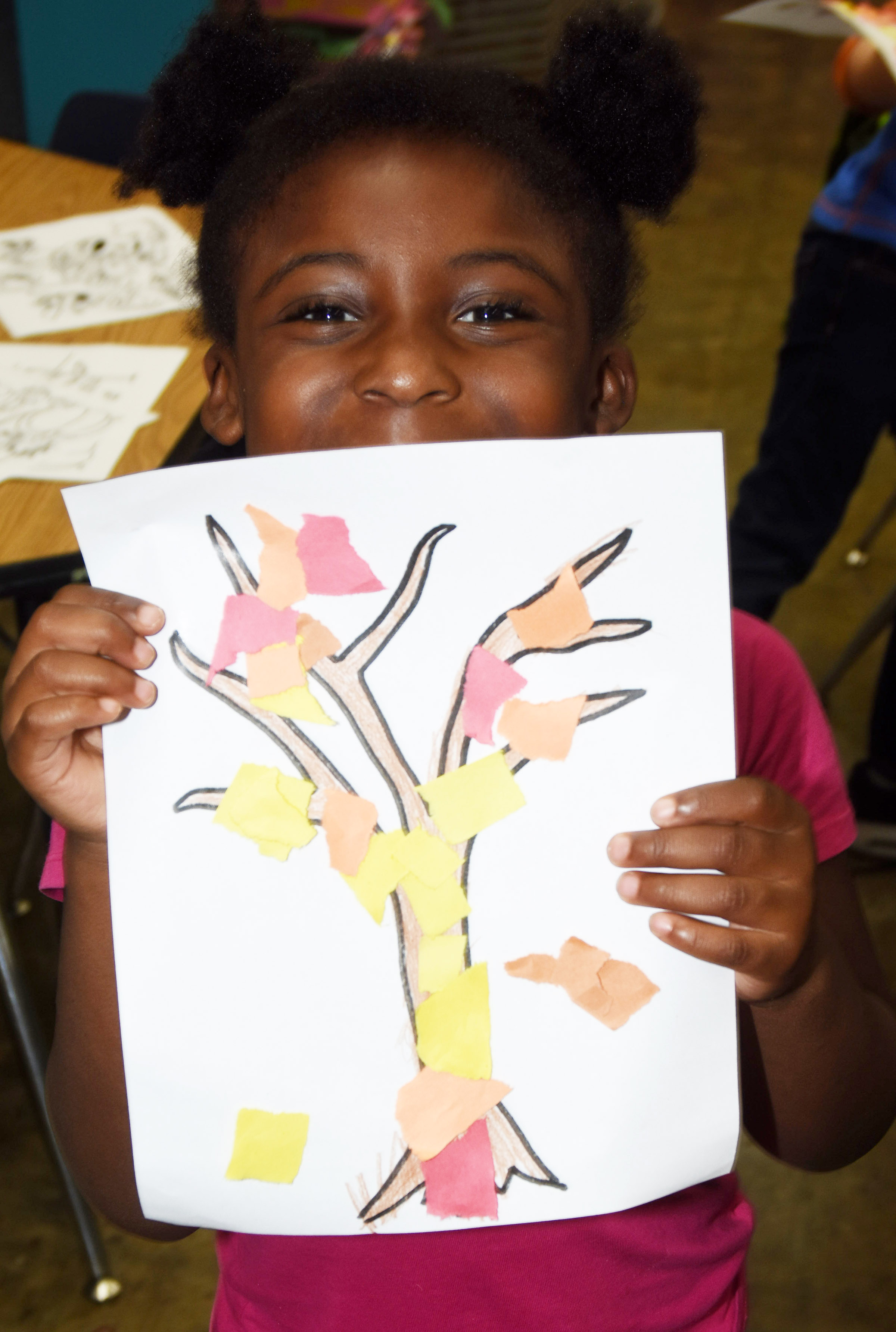 CES kindergartener Harmony Brown holds her fall tree.