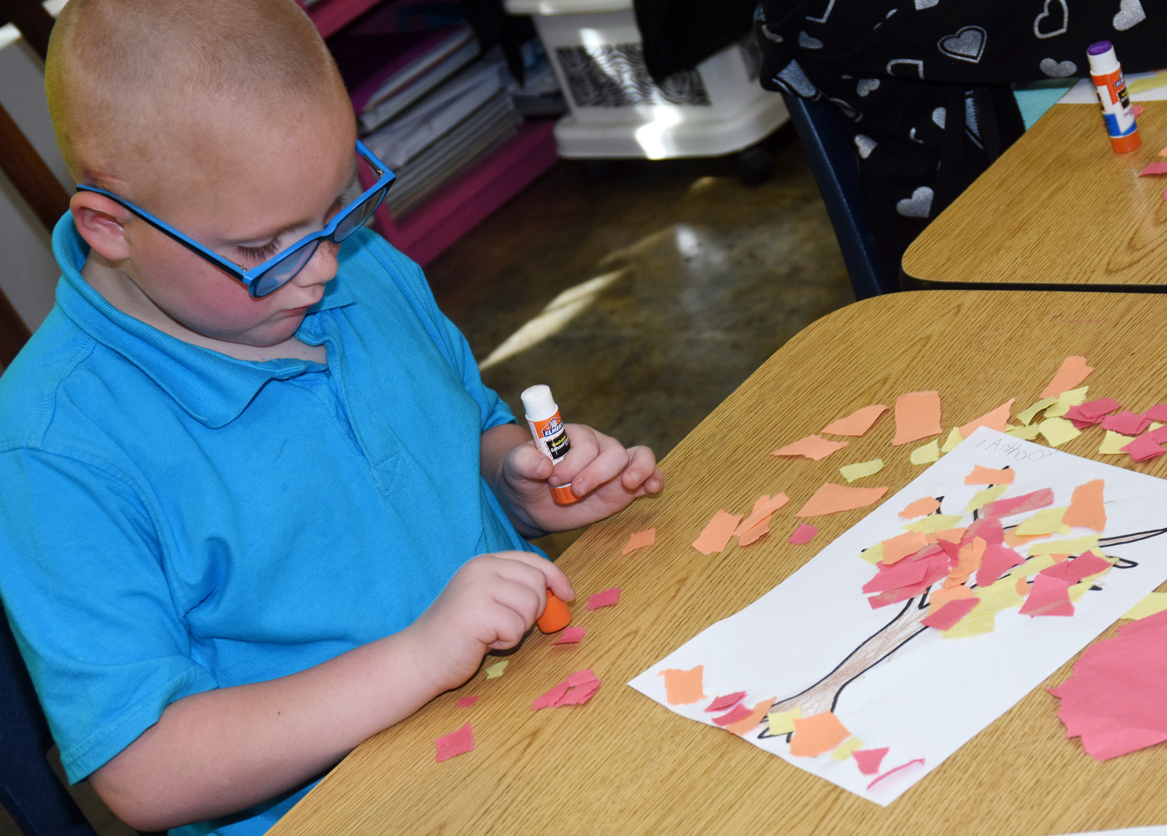 CES kindergartener Anthony McClure makes his fall tree.