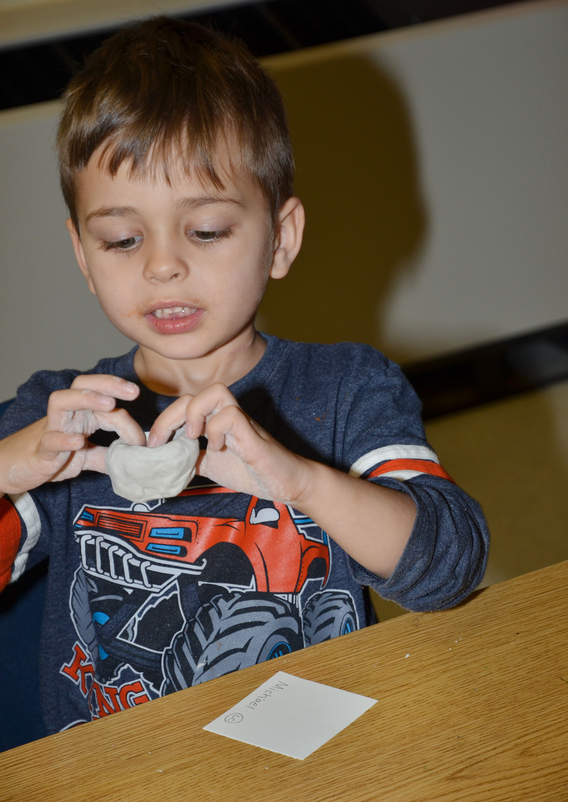 CES kindergartener Michael Terry forms his pinch pot.