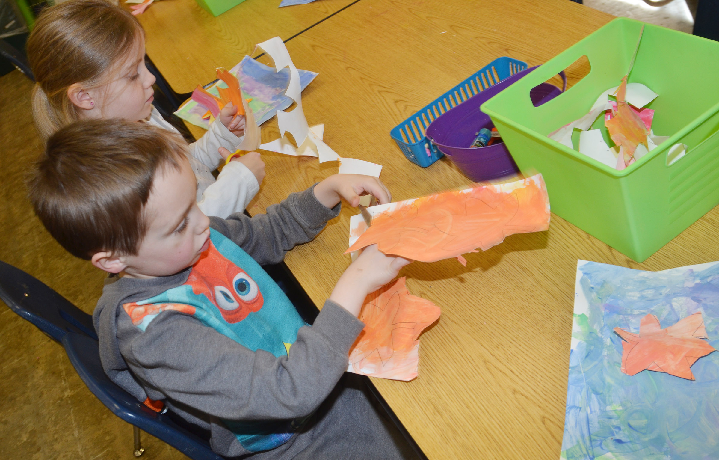 CES kindergarteners Courtney Gilbert, at left, and Joshua Dickens cut out their leaves.