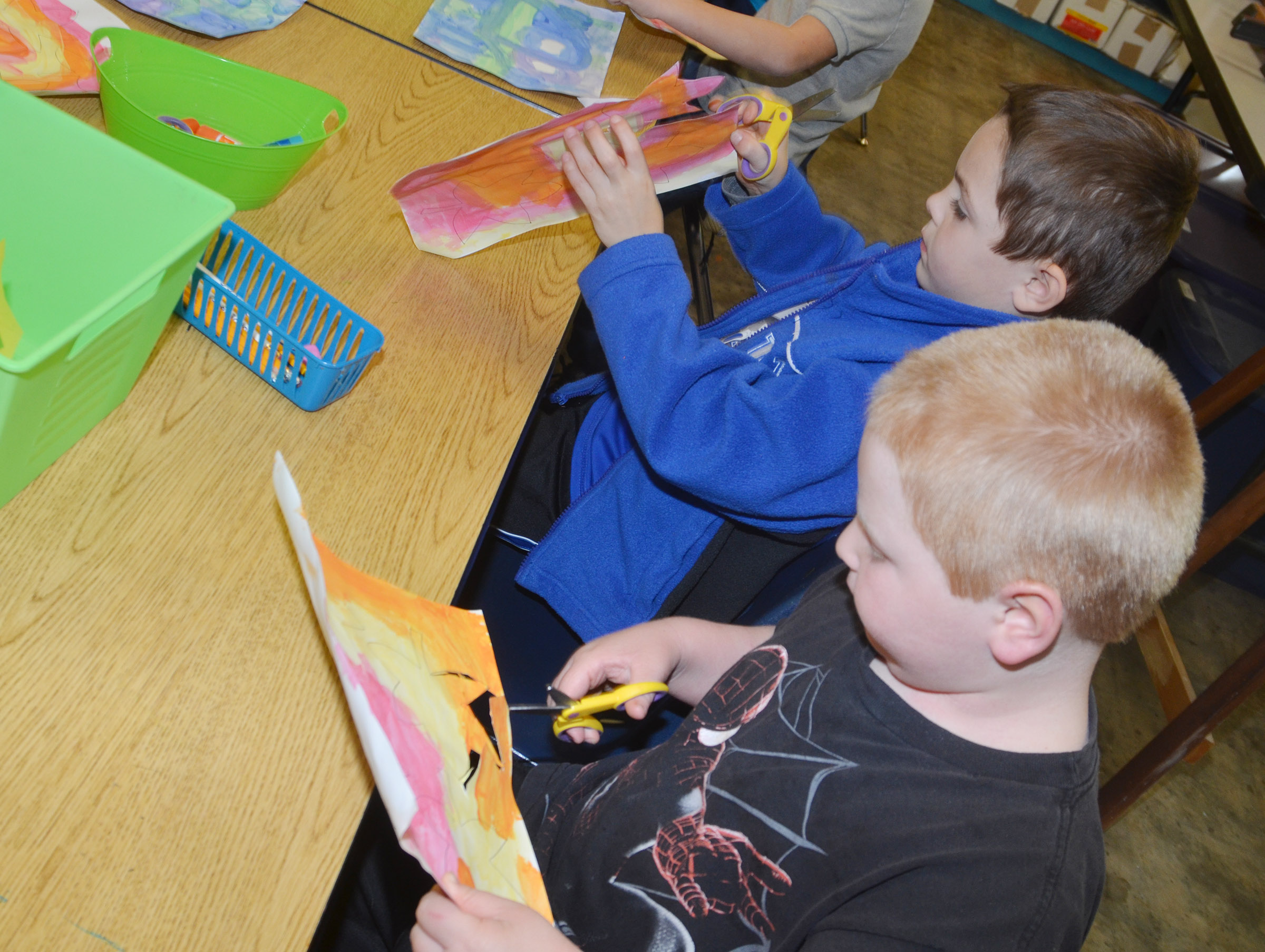CES kindergarteners Hayden Goff, at left, and Konnar Hicks cut out their leaves.