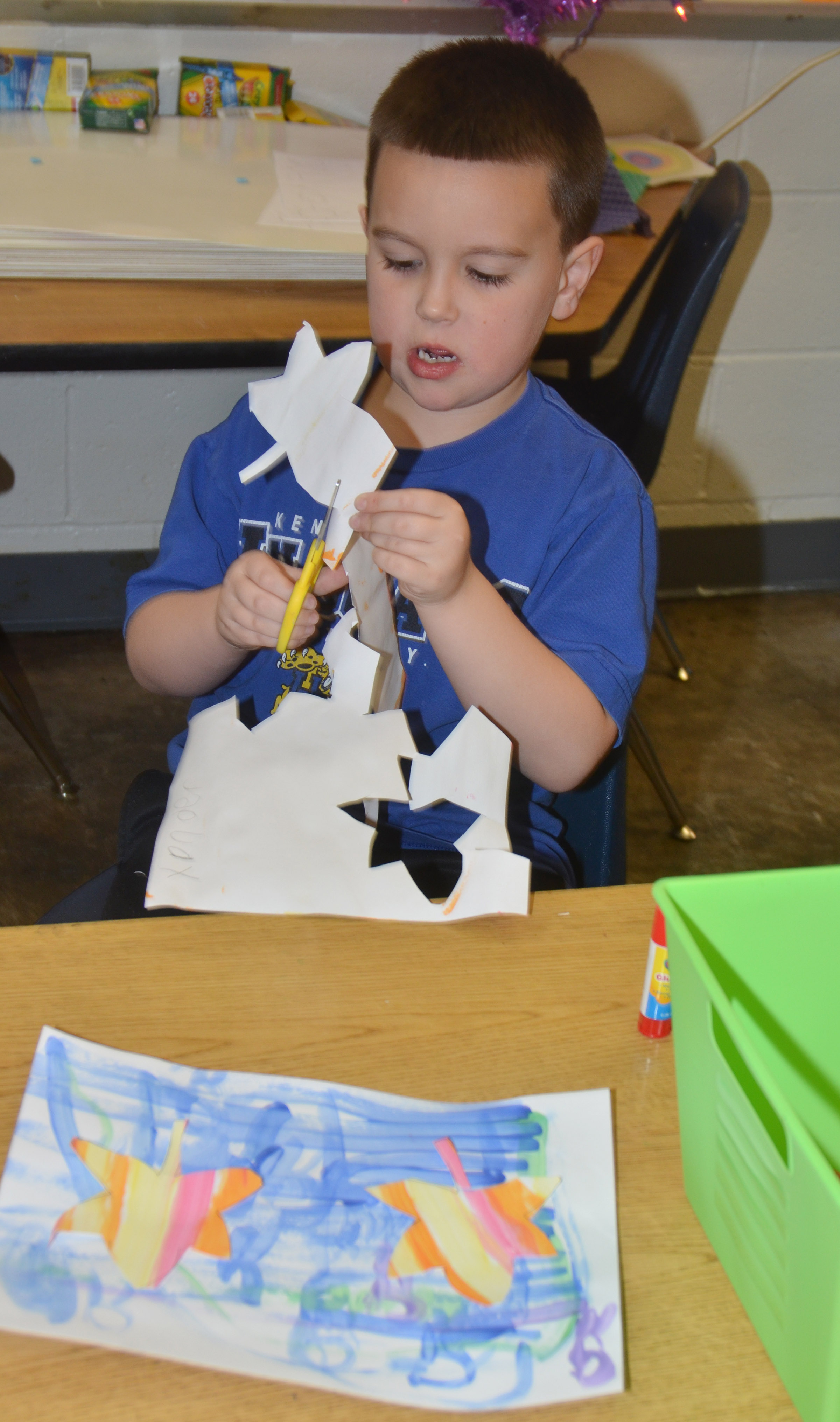 CES kindergartener Xander Britton cuts out his leaves.