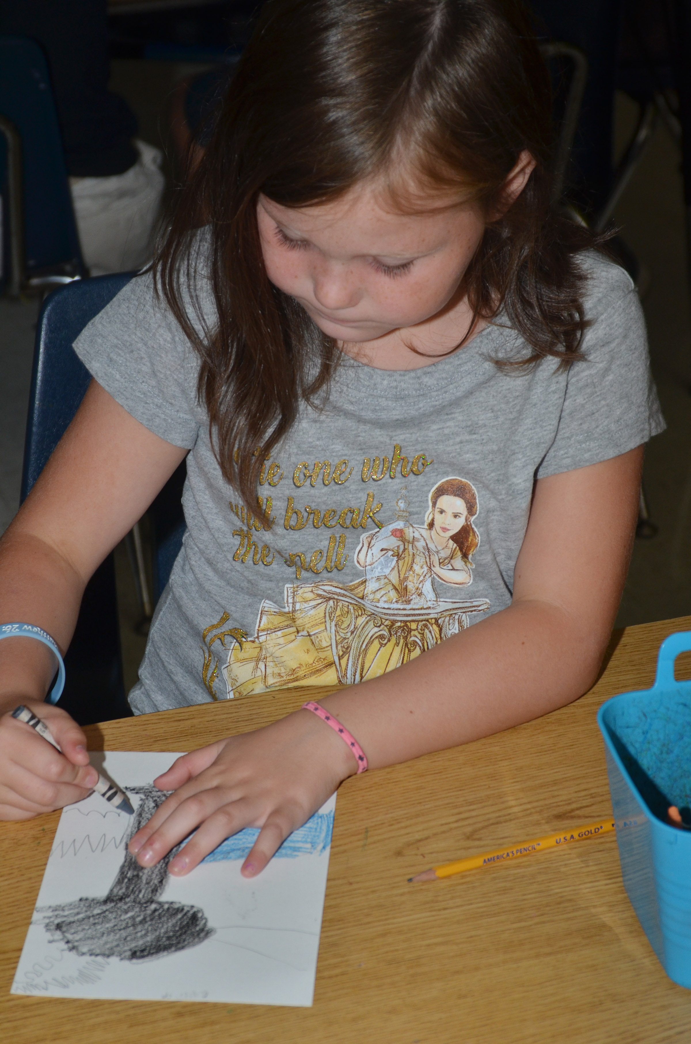 CES second-grader Cadynce Cox colors her line tree.