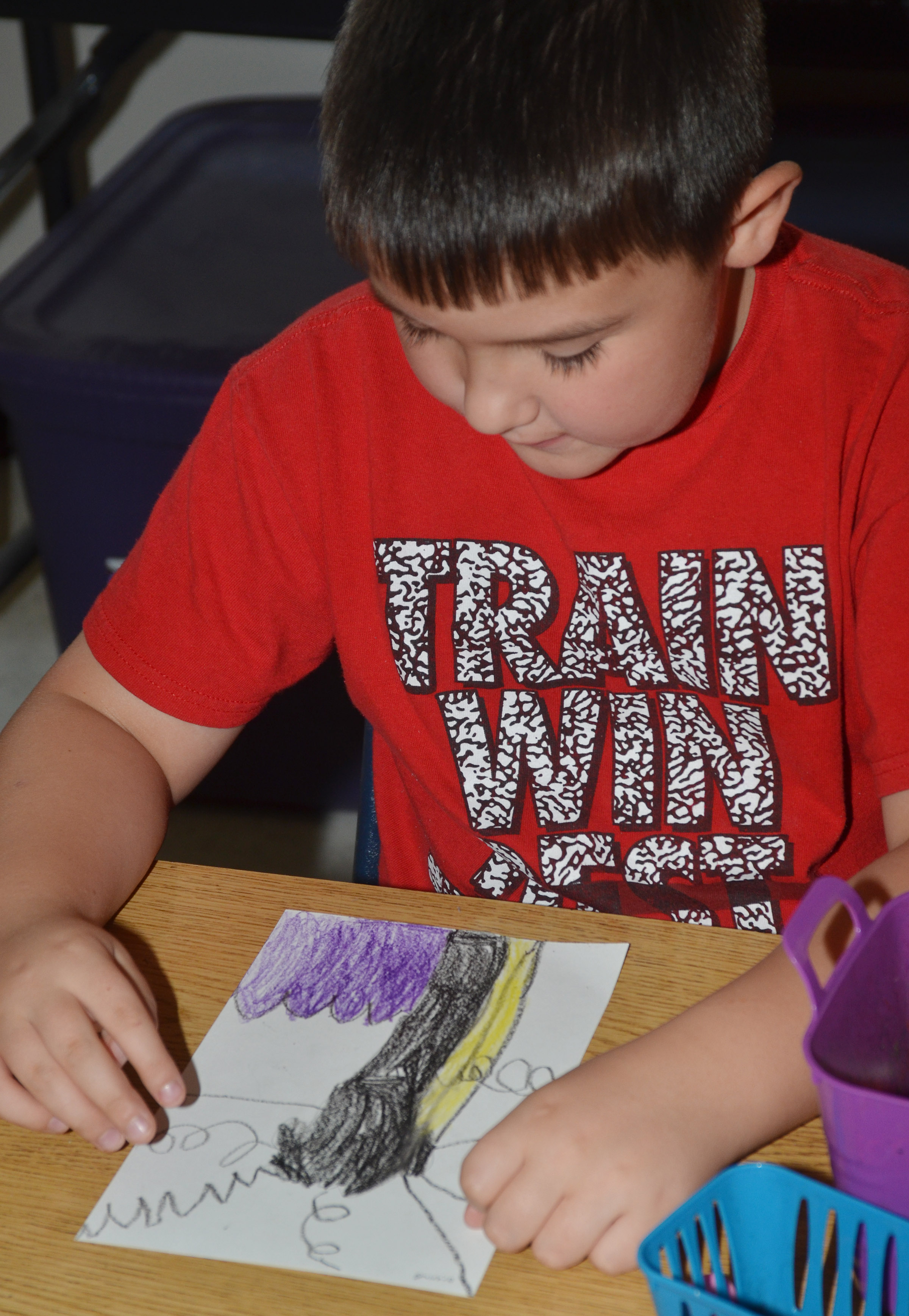 CES second-grader Braxton Giles-Osinger colors his line tree.