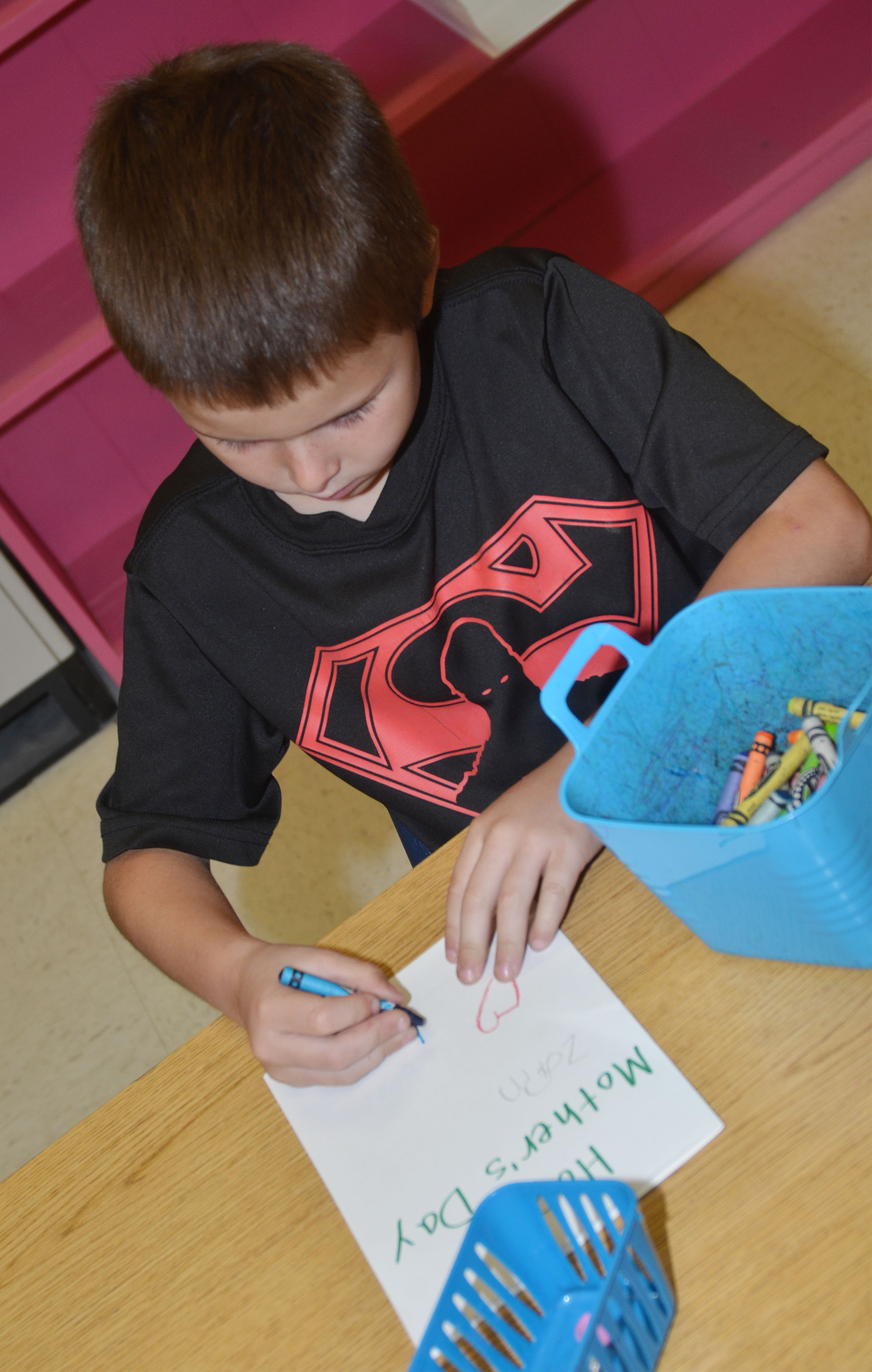 CES kindergartener Zain Mullins colors his Mother's Day card.