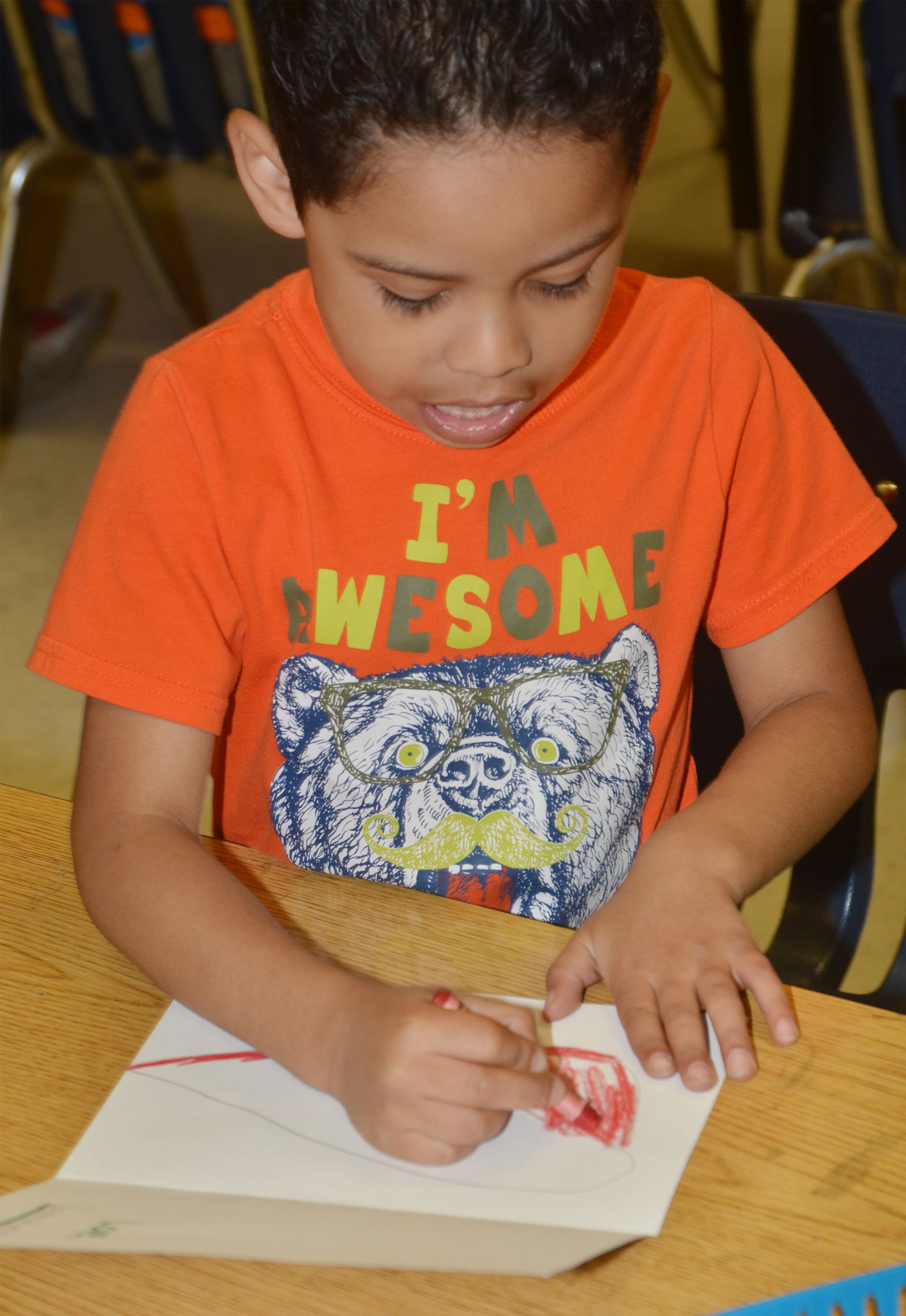 CES kindergartener Demarcus Noyola colors his Mother's Day card.
