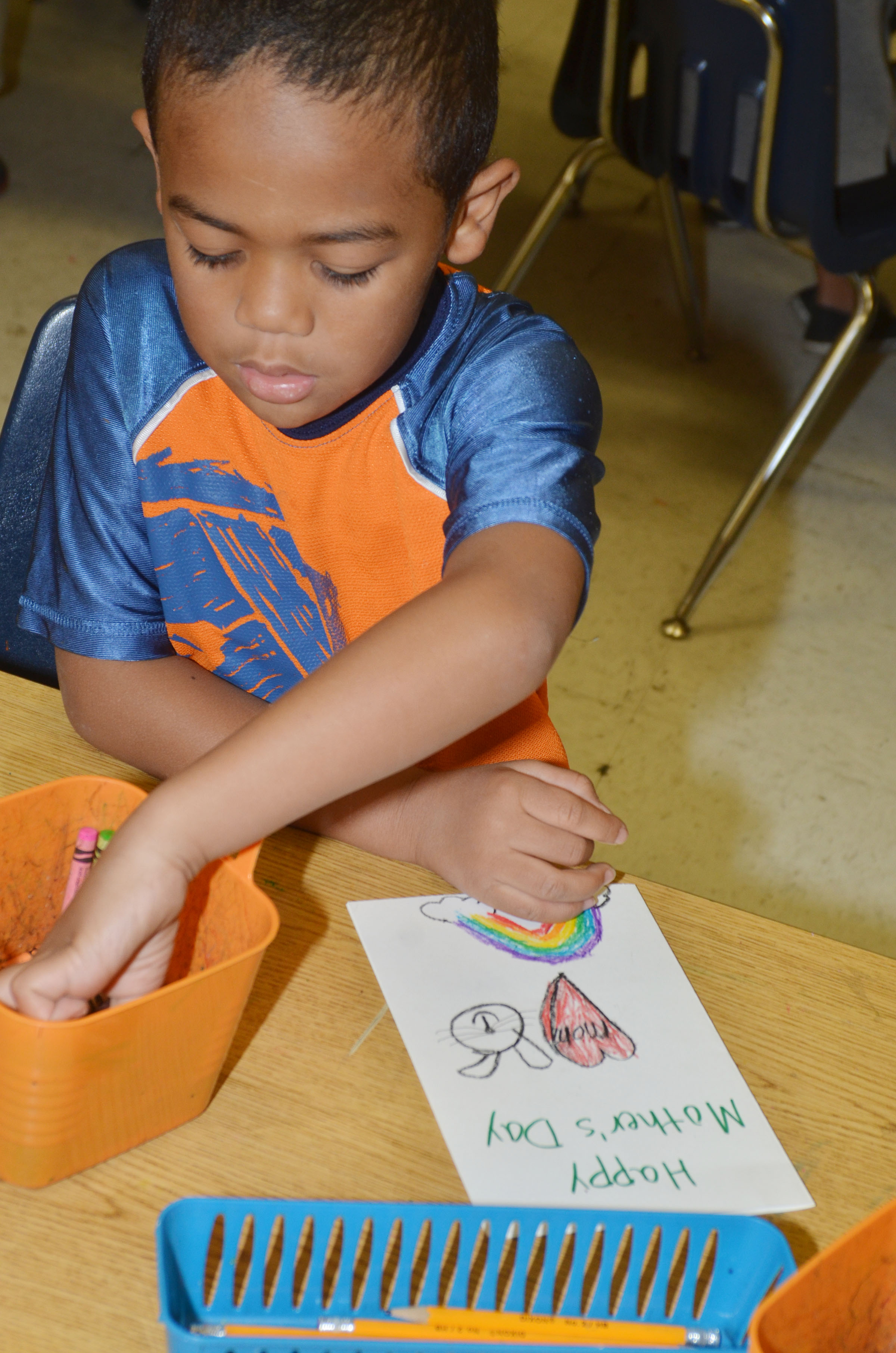 CES kindergartener Tyler Branch colors his Mother's Day card.