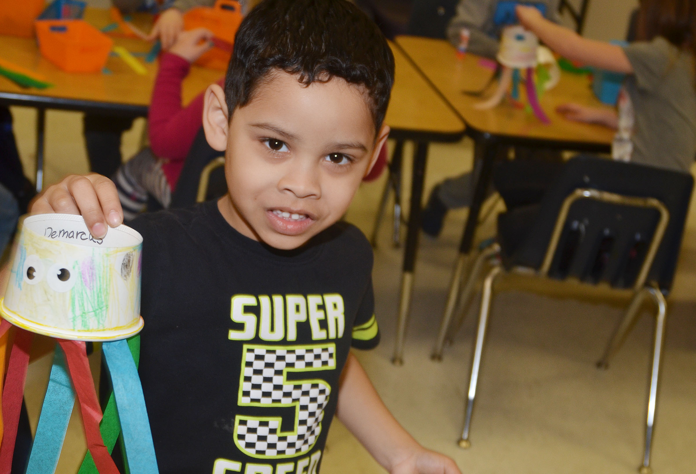CES kindergartener Demarcus Noyola holds his finished octopus.