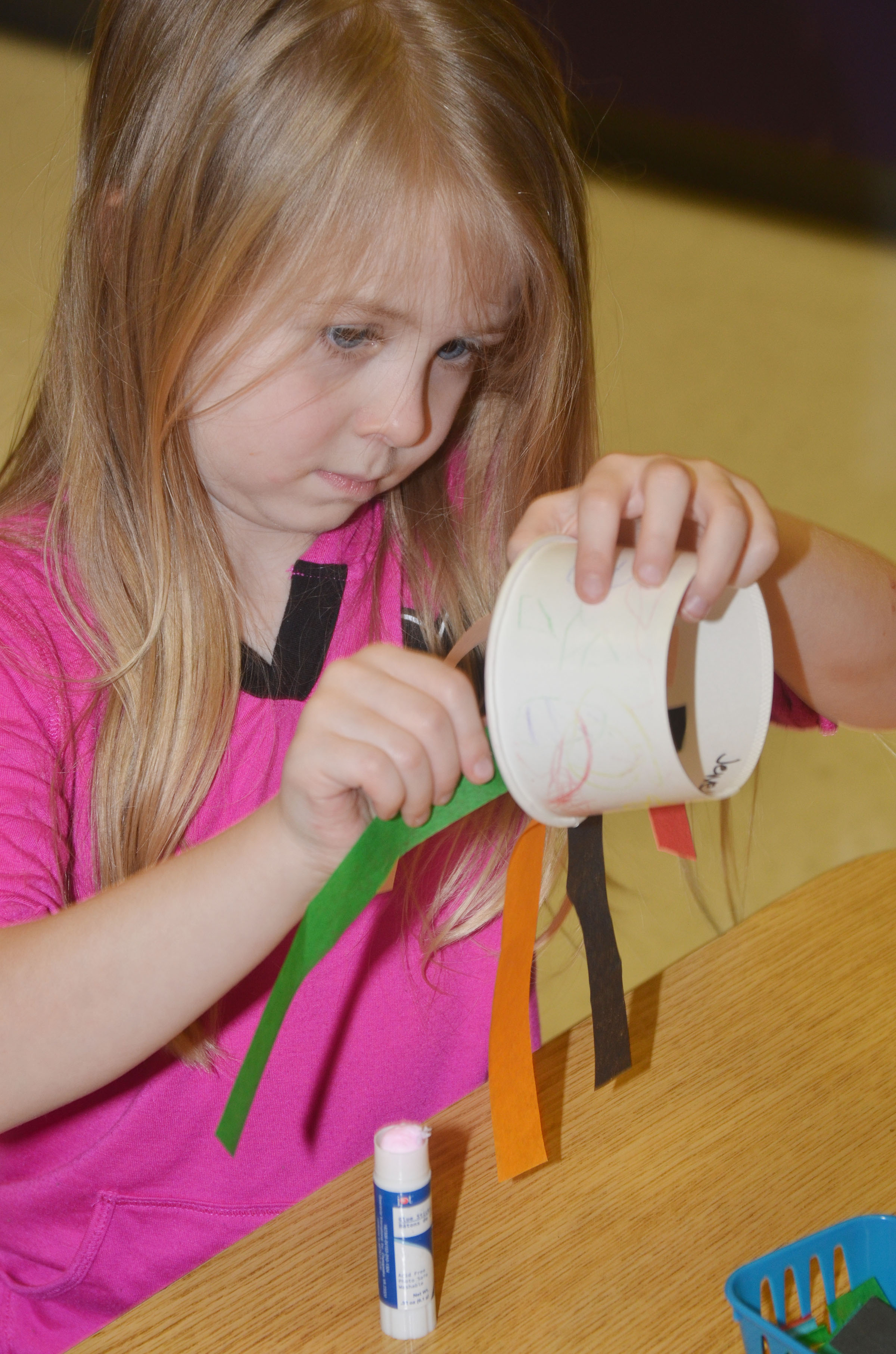 CES kindergartener Jewell Brewster glues her tentacles.