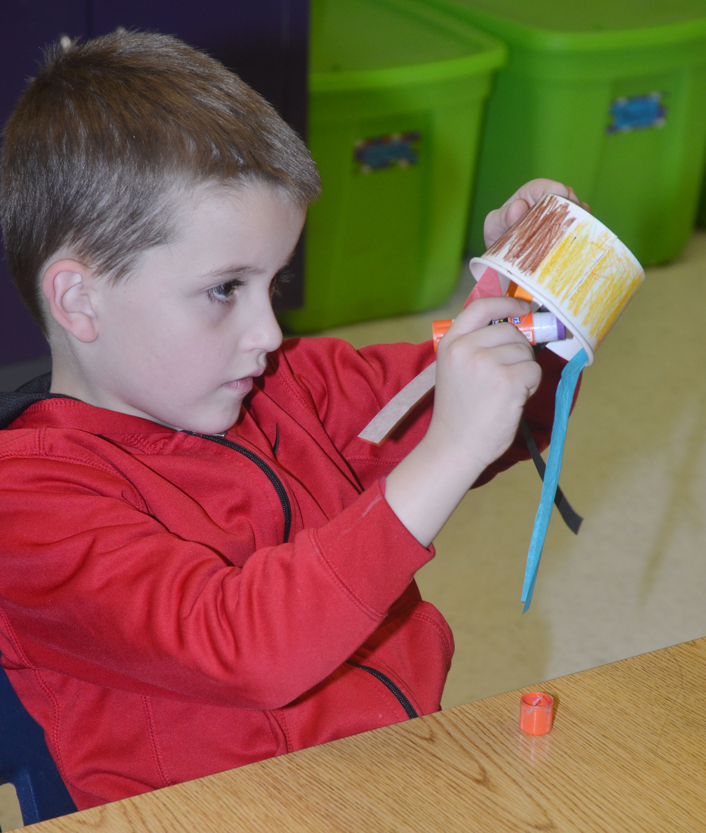 CES kindergartener Timothy Stacy glues his tentacles.