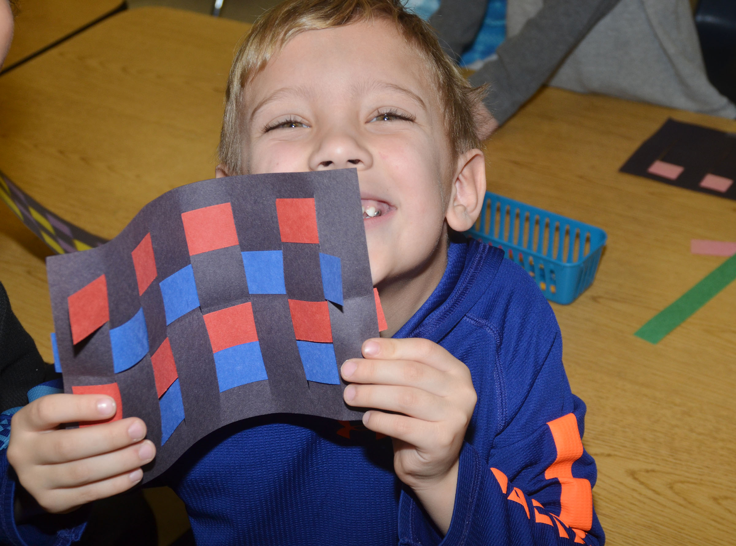 CES first-grader Gabe Prior holds his finished mat.