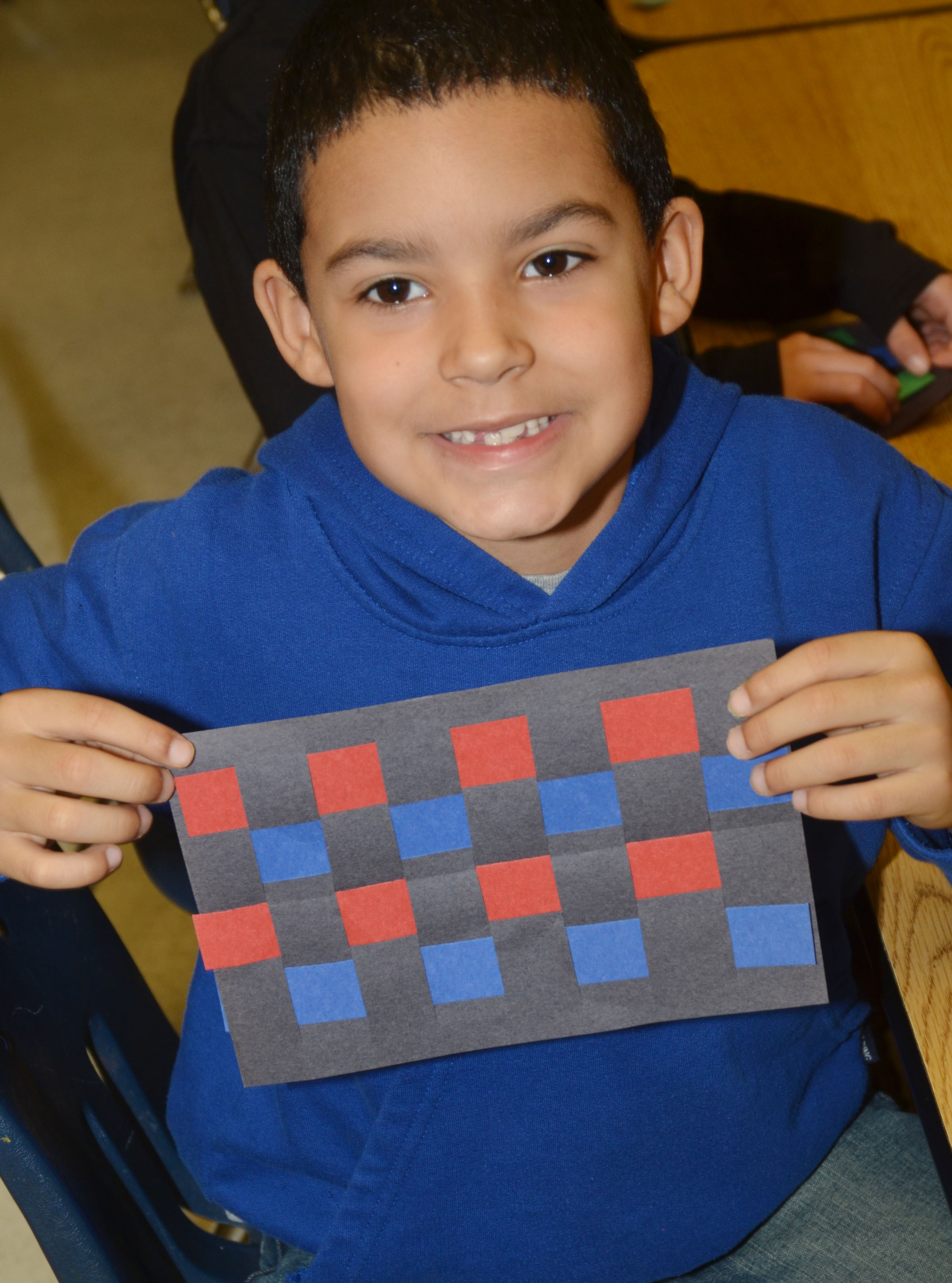CES first-grader Rizzo McKenzie holds his finished mat.