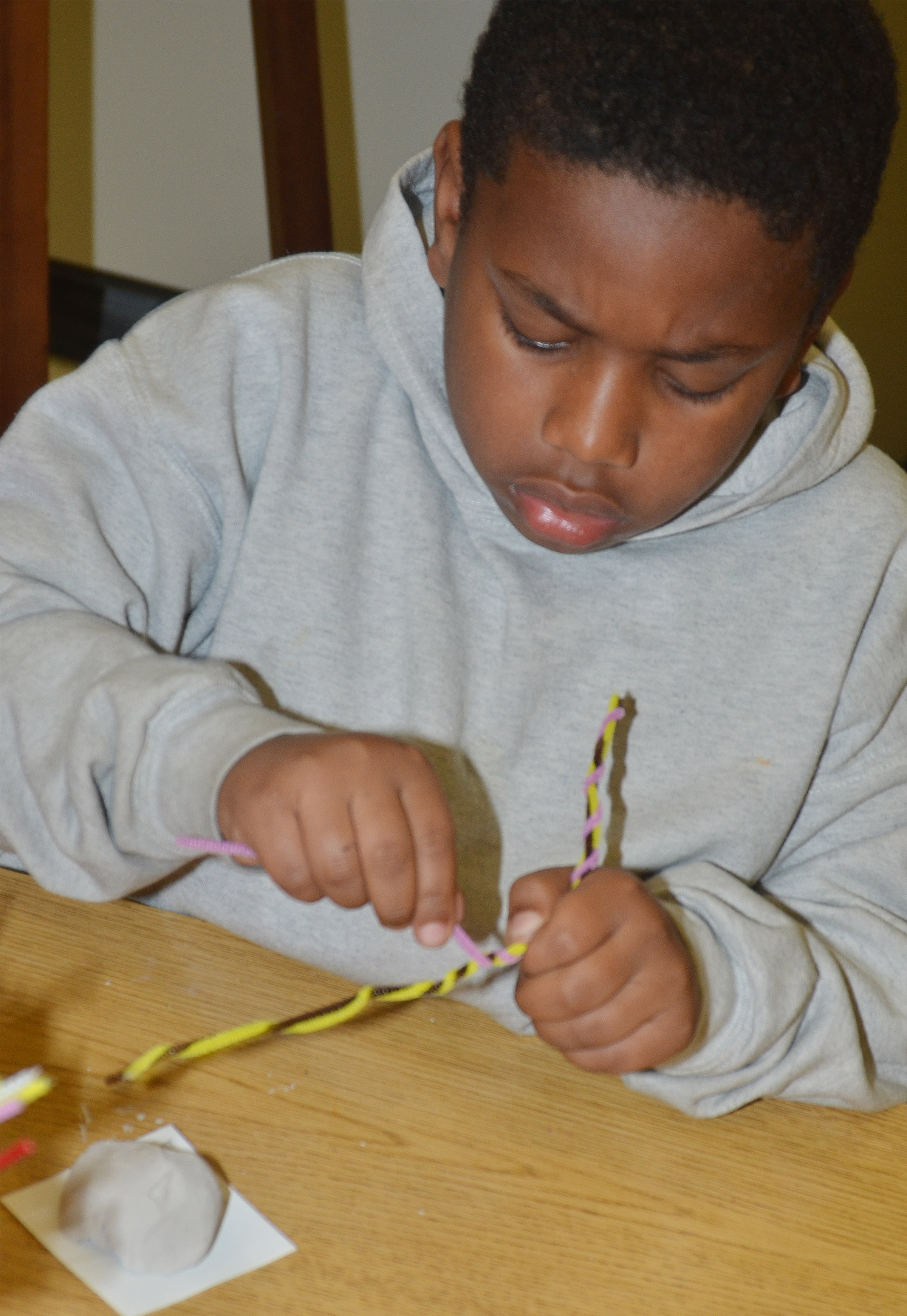 CES second-grader Elijah Spurling twists his pipe cleaners.