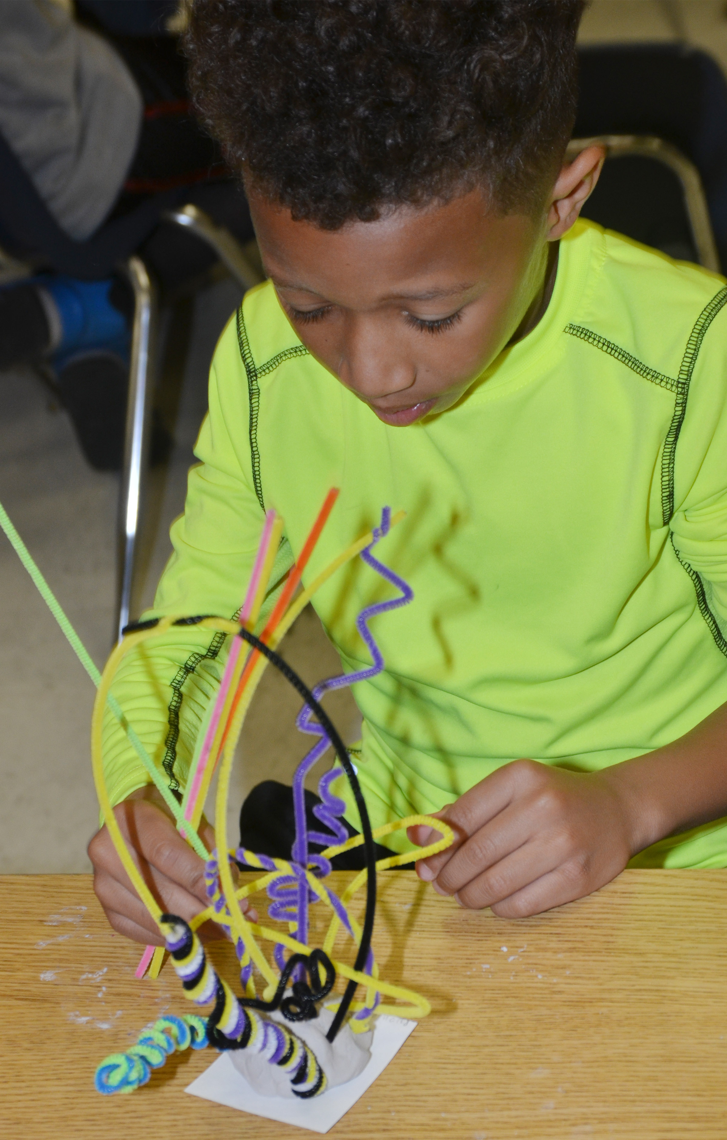 CES second-grader Rajon Taylor builds his pipe cleaner sculpture.