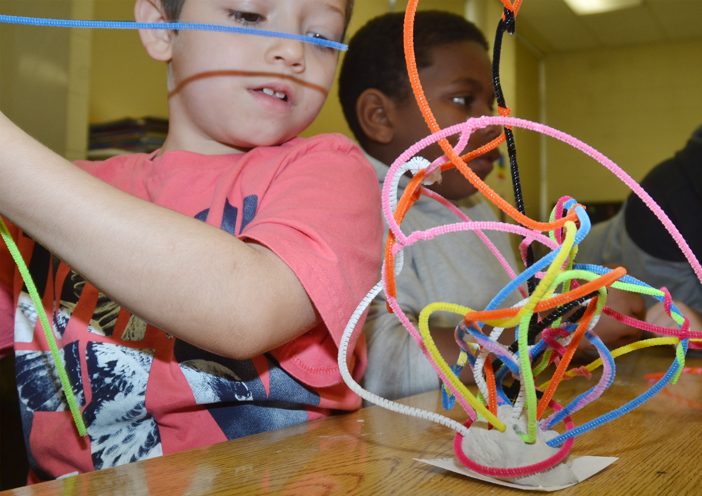CES second-grader Dre Gurley builds his pipe cleaner sculpture.