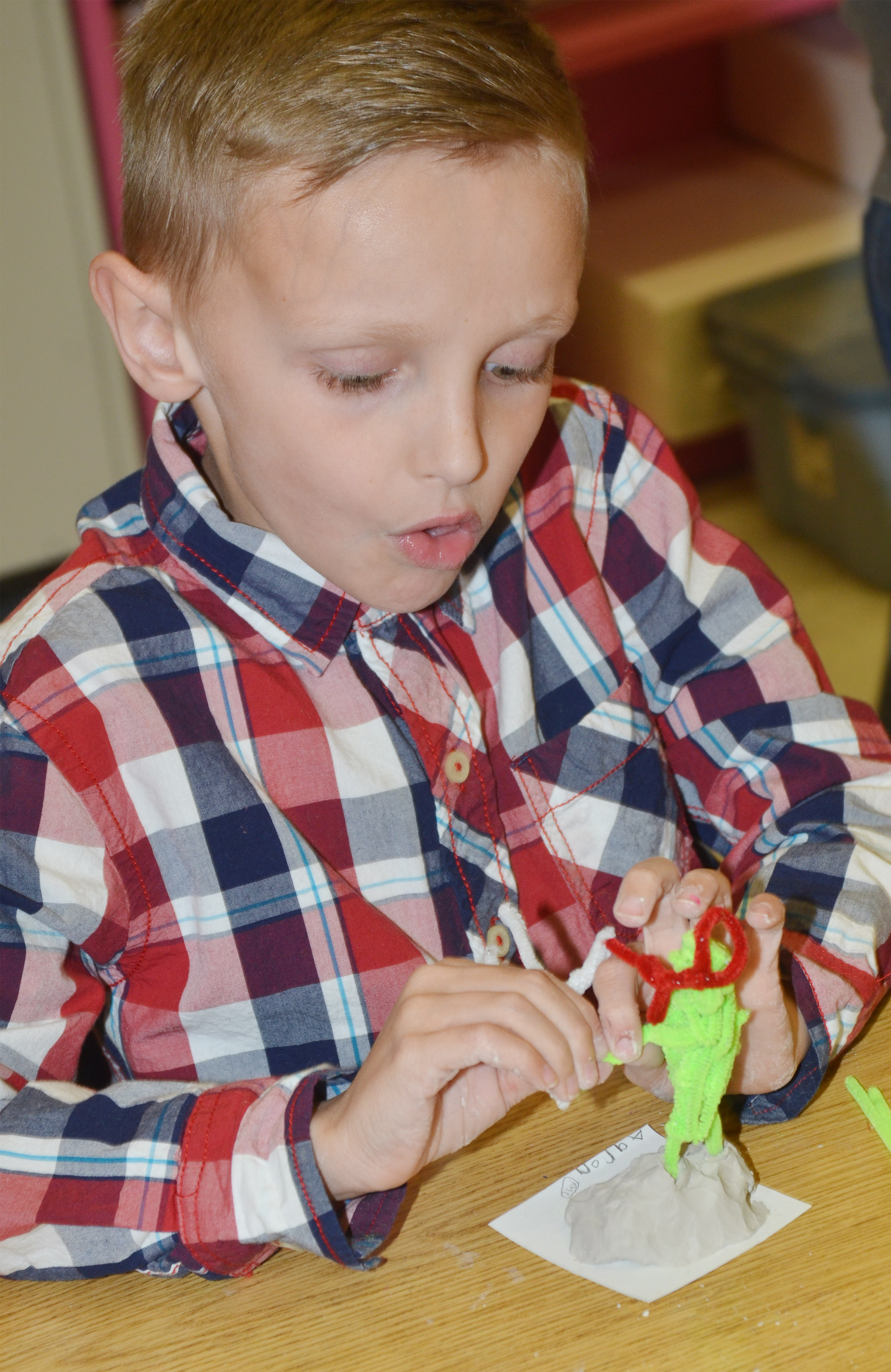 CES second-grader Aaron Ritchie builds a ninja turtle out of pipe cleaners.