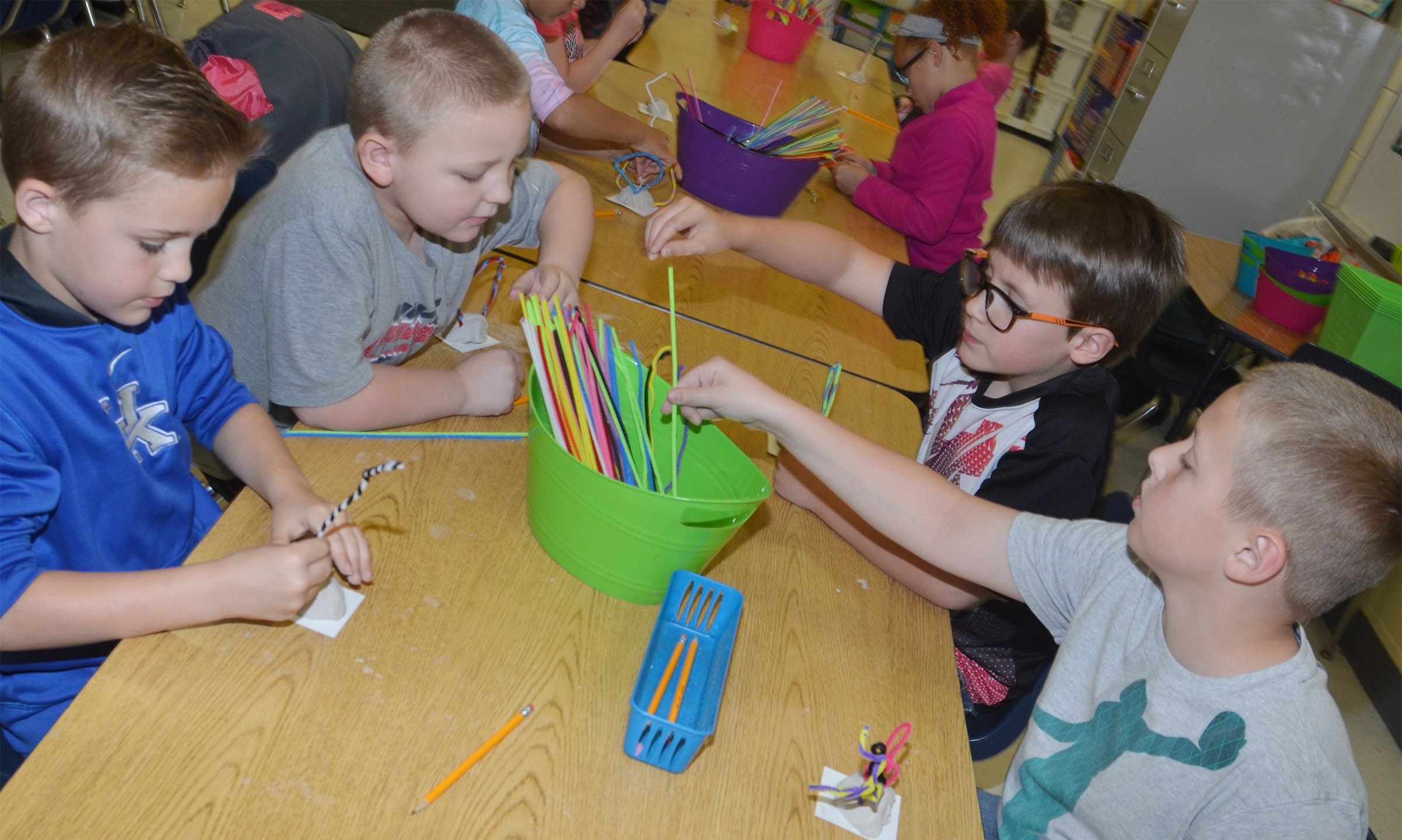 From left, CES second-graders Kadin Coppage, Peyton Mitchell, Dalton Shively and Evan Lockridge make their pipe cleaner sculptures.