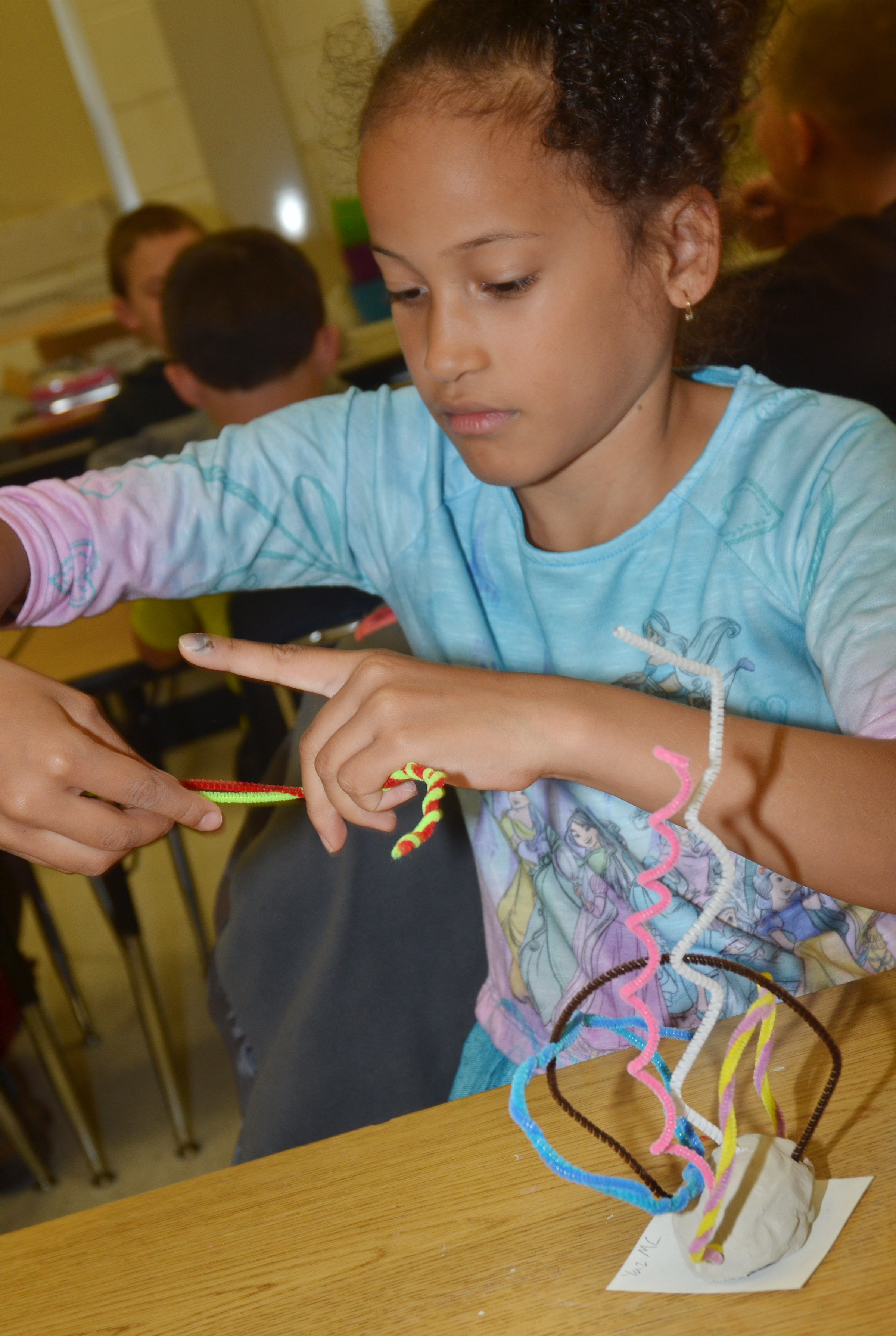 CES second-grader Yazlyn Sutton twists her pipe cleaners.