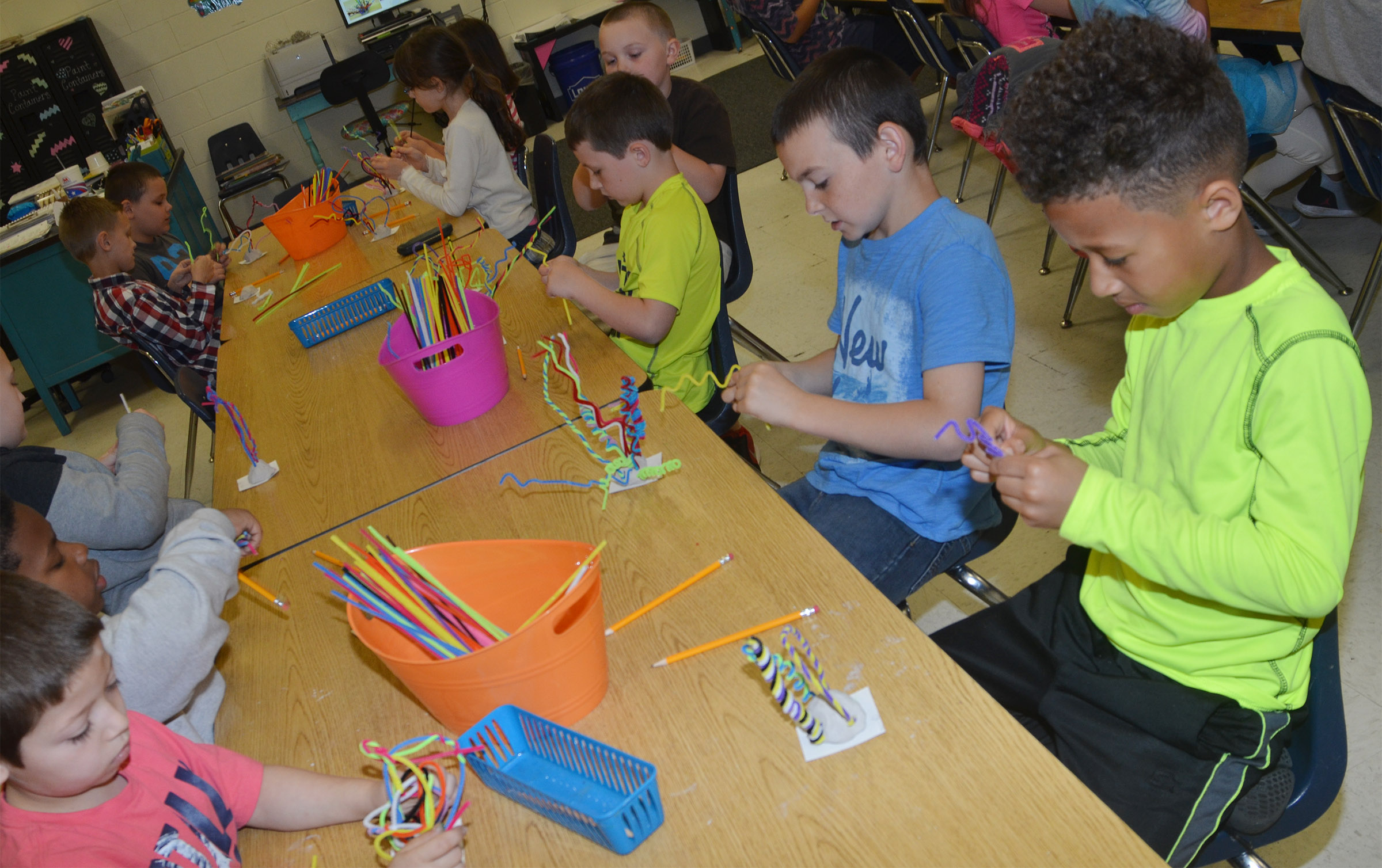 CES second-grader Rajon Taylor and his classmates build their pipe cleaner sculptures.