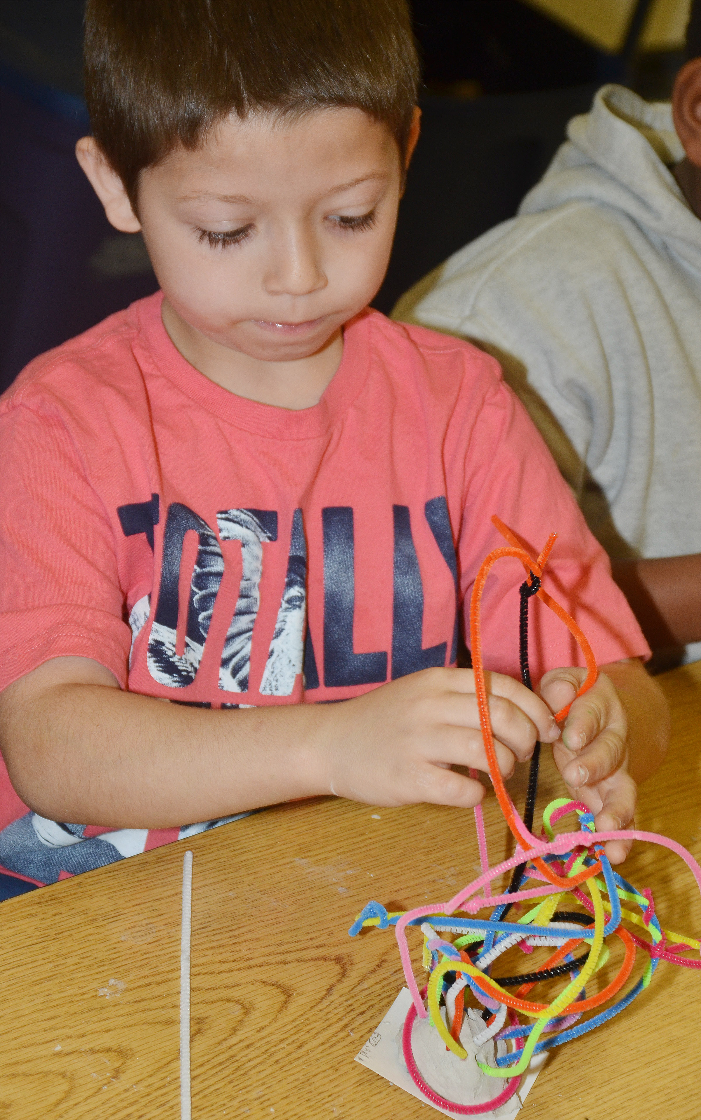 CES second-grader Dre Gurley builds his pipe cleaner sculptures.