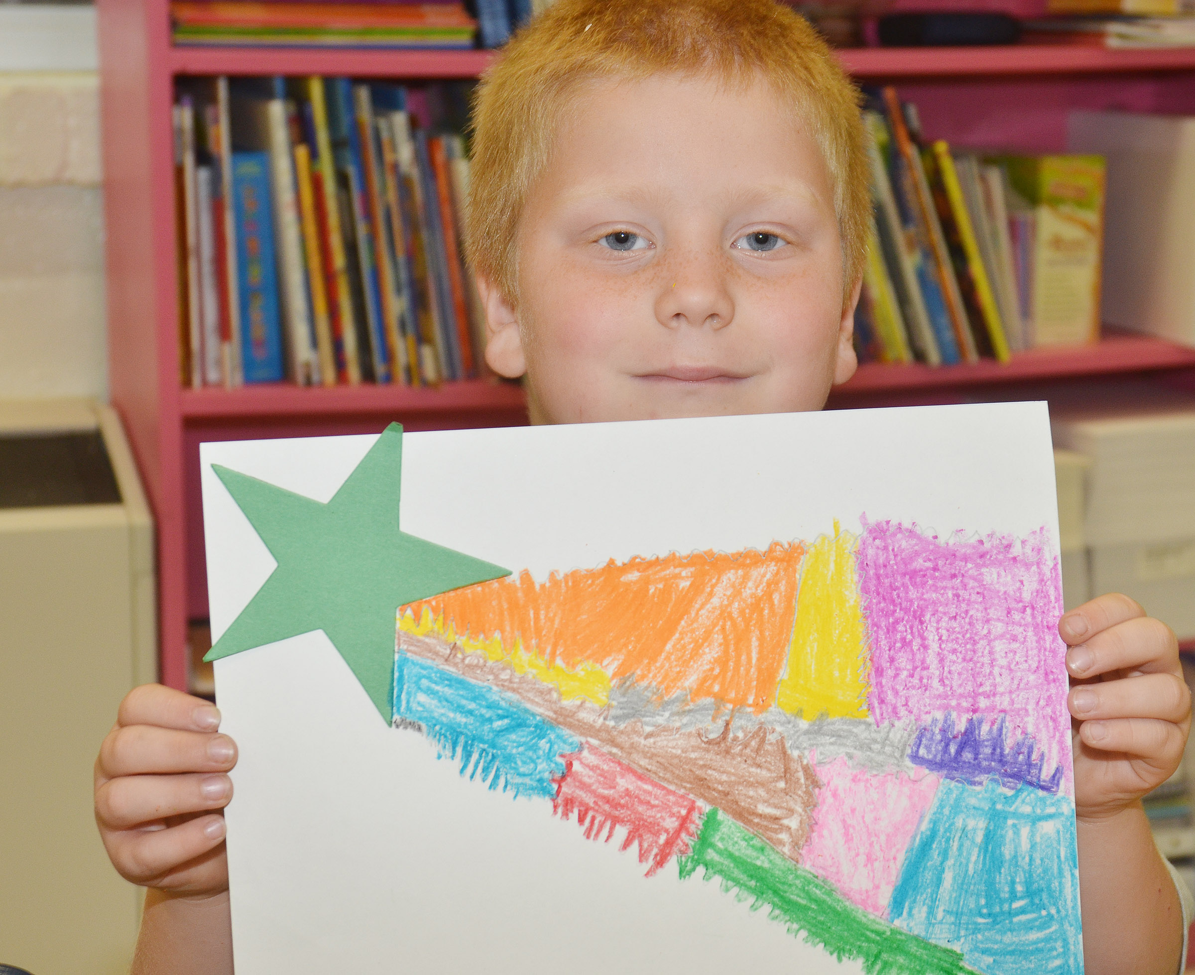 CES second-grader Ben Parrott holds his shooting star.