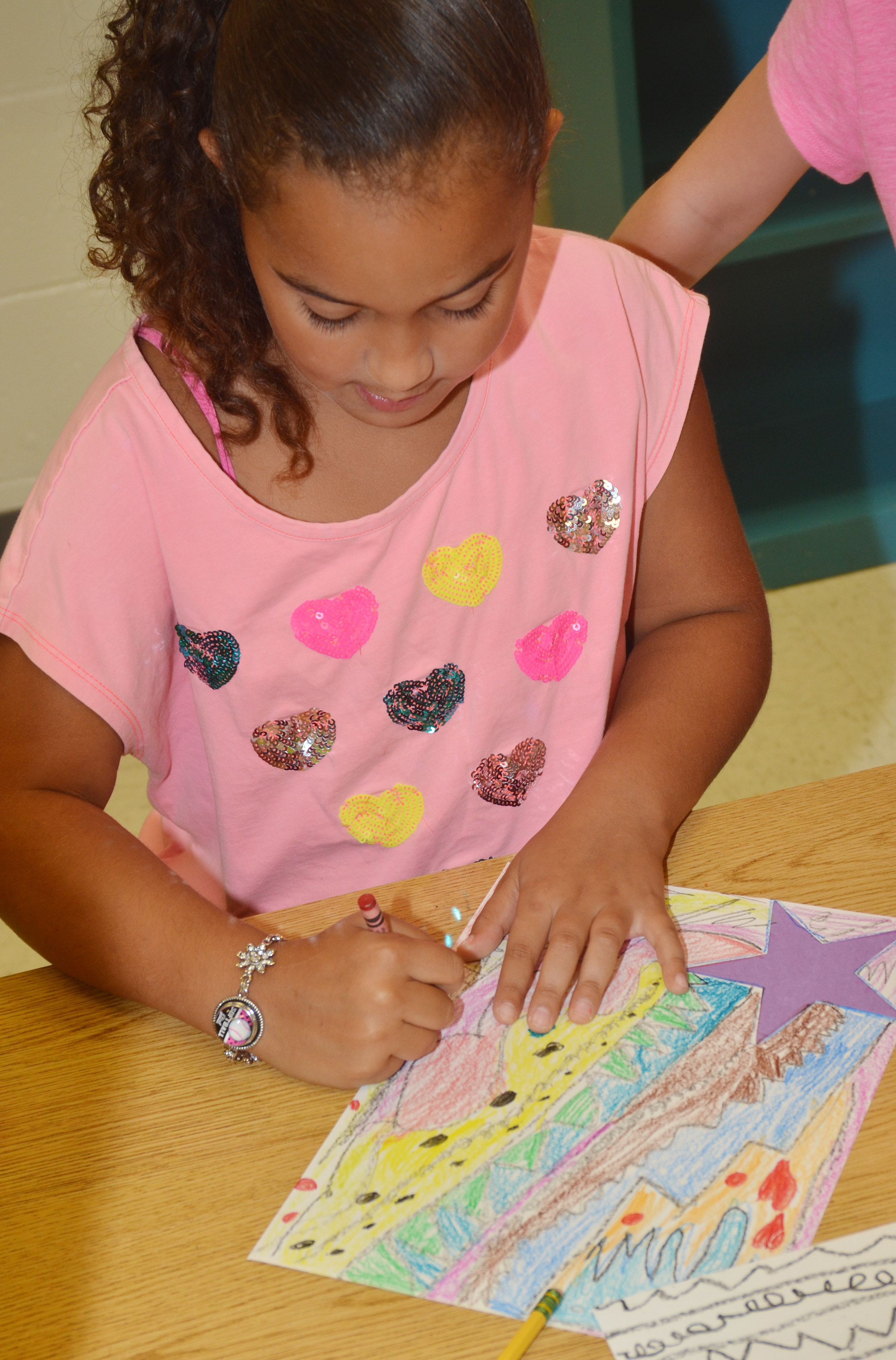 CES second-grader Maleigha Travis colors her shooting star.