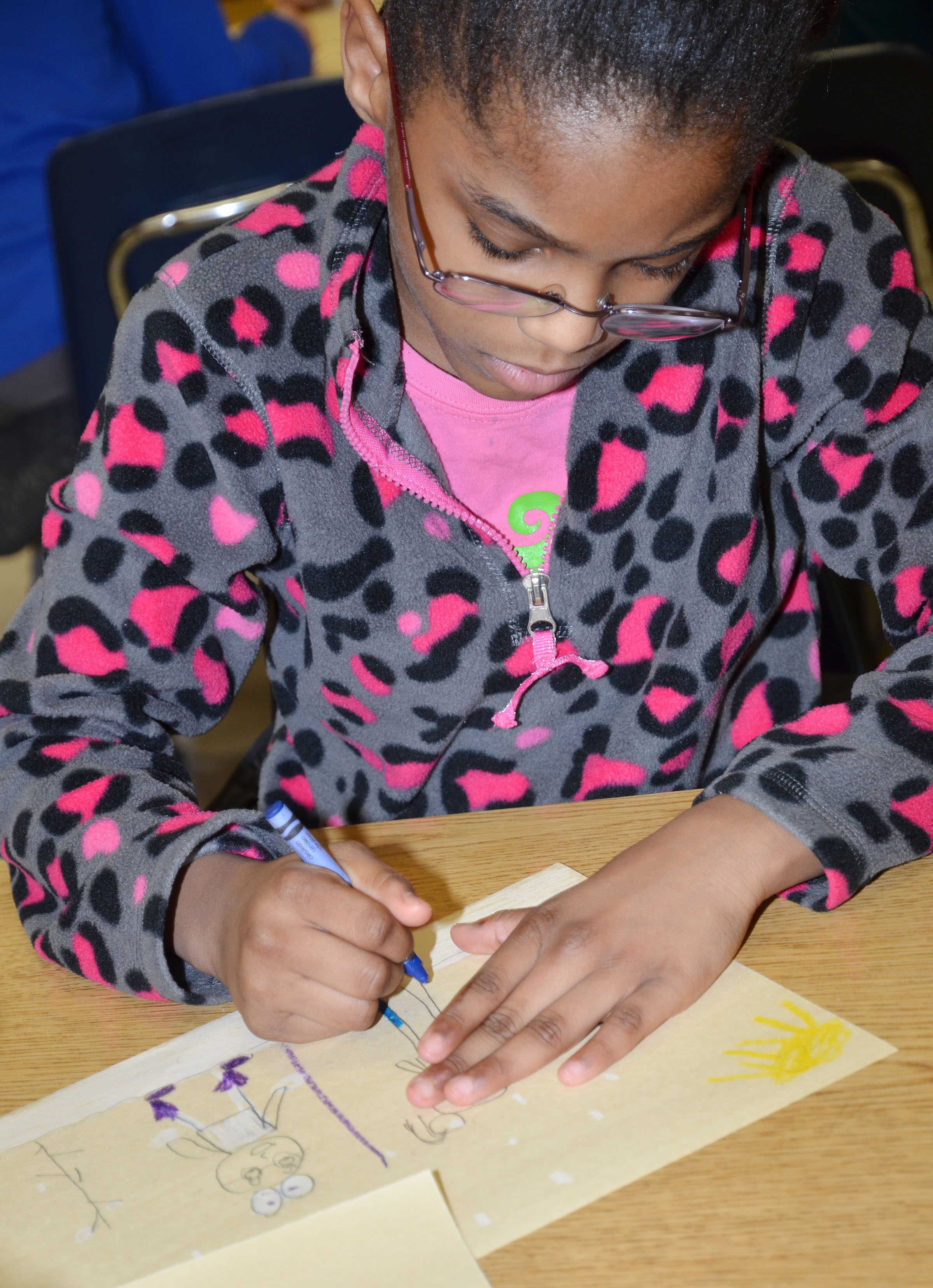 CES third-grader Maliyah Harris colors her snow picture.
