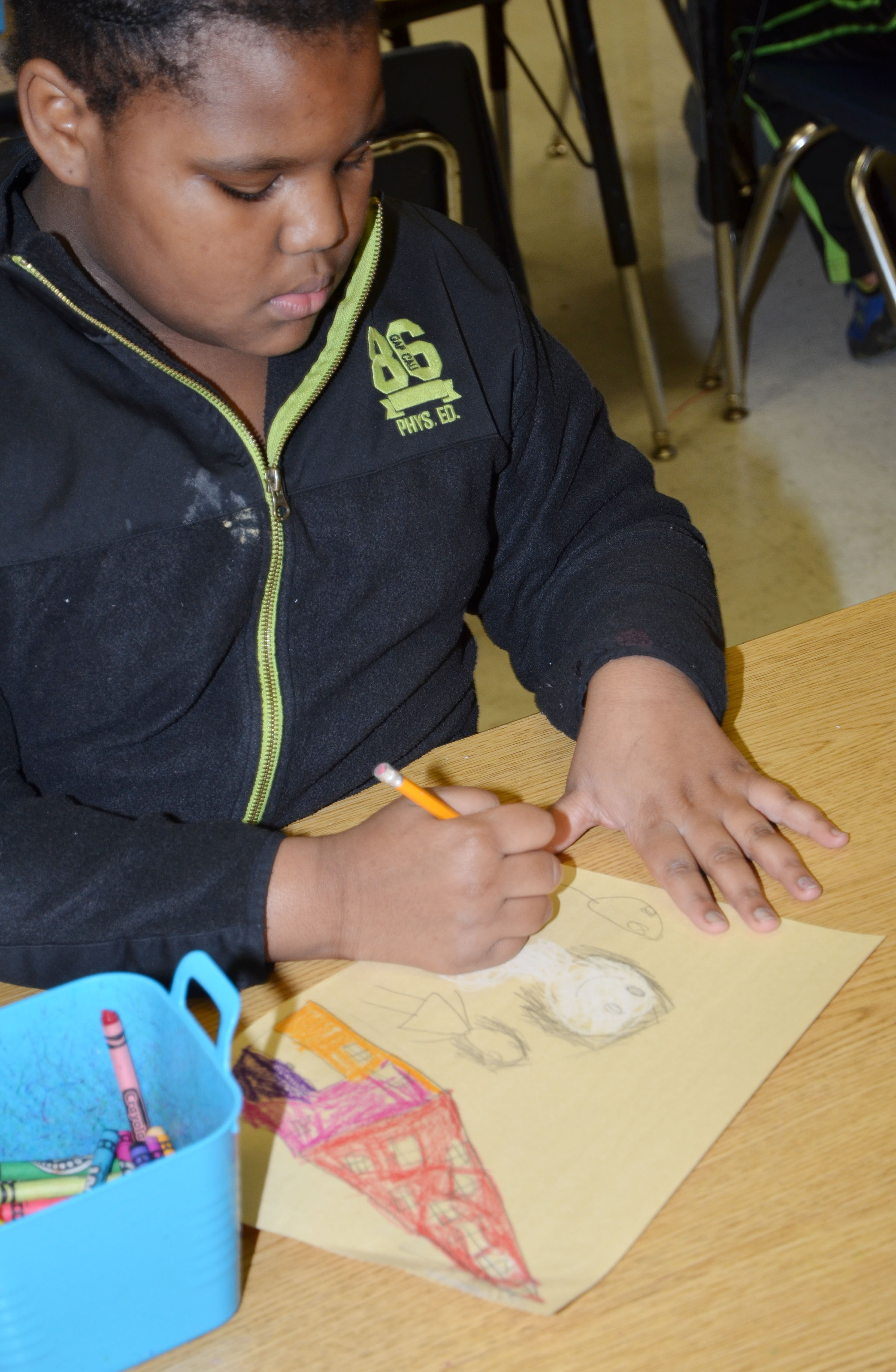 CES third-grader Talaysia Daniels colors her snow picture.