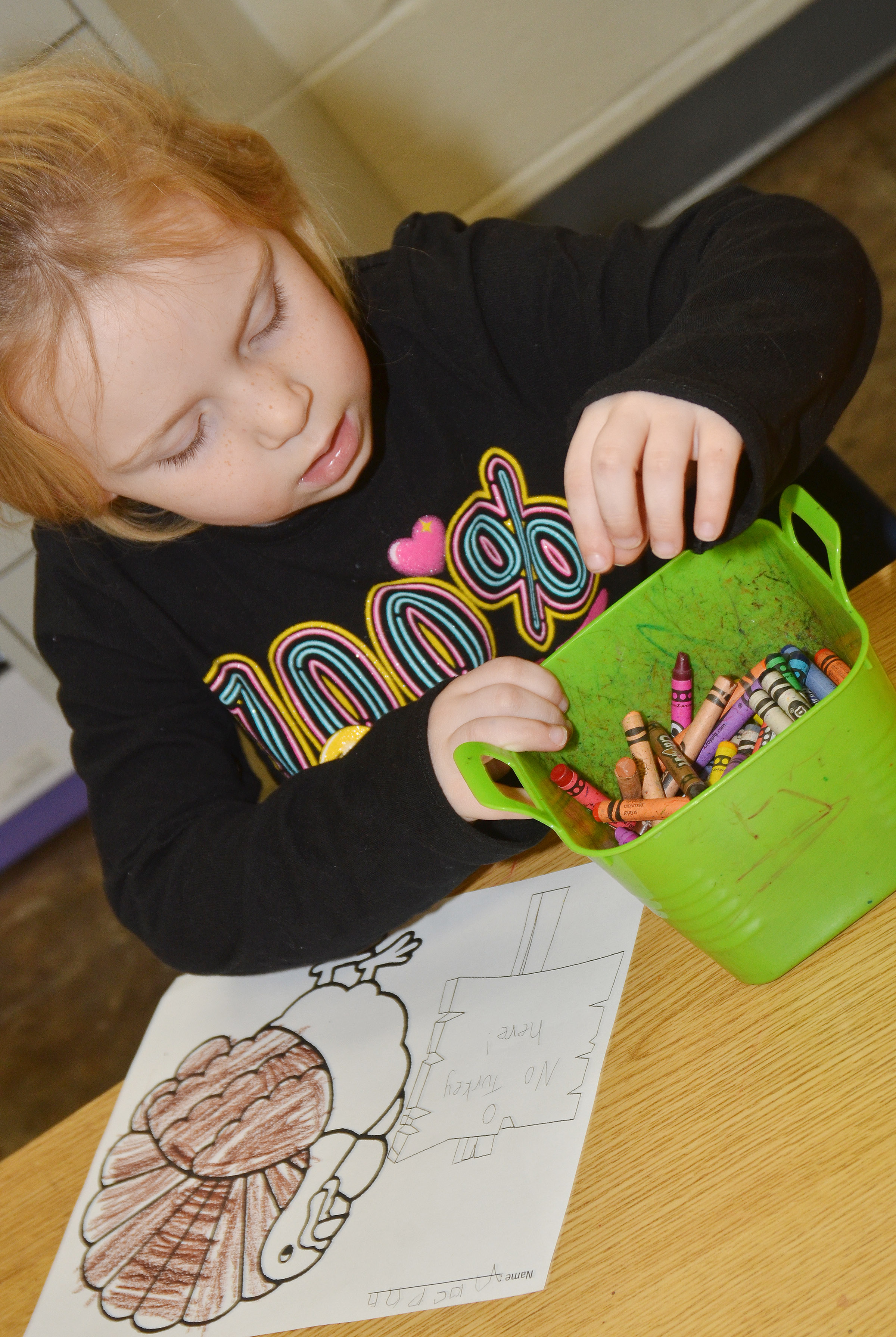 "CES kindergartener Macilynn Mann colors her turkey. Her sign reads ""No Turkey Here!"""