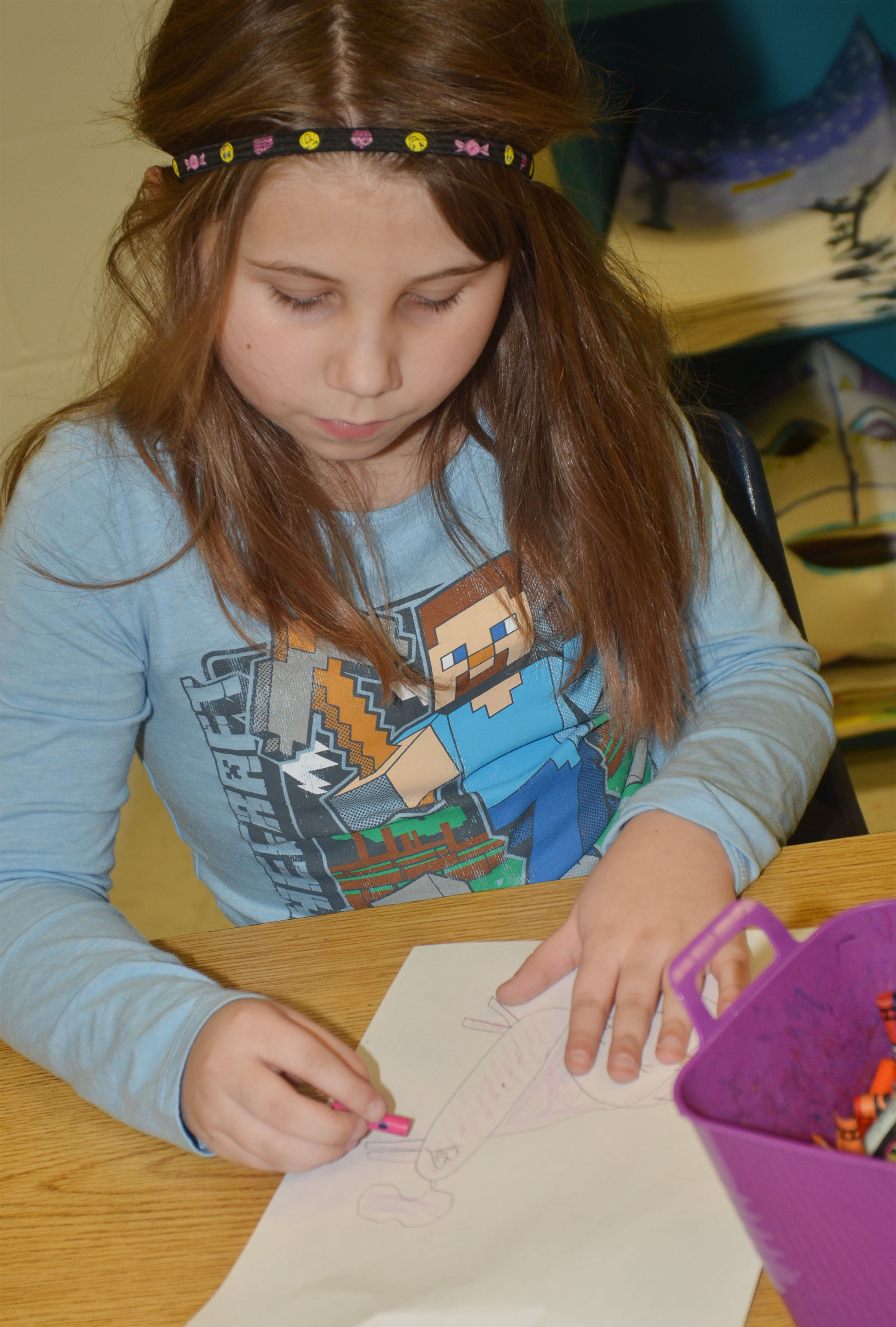 CES second-grader Natalia West adds texture to her animal drawing.