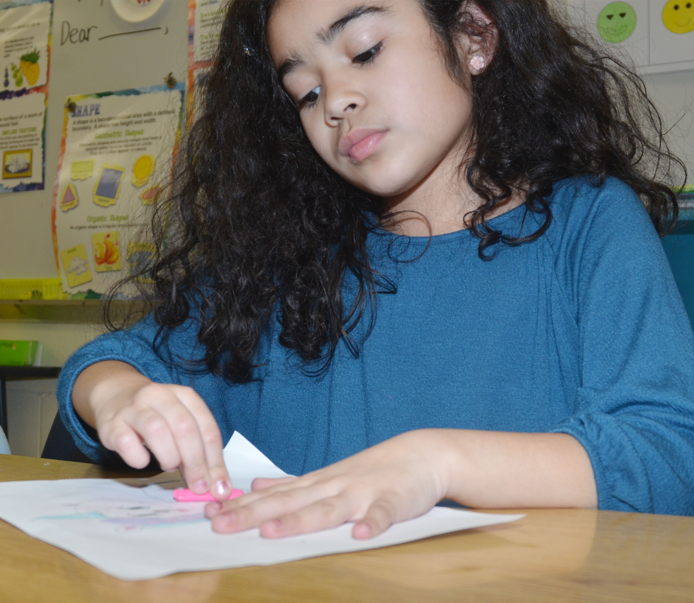 CES second-grader Sophia Santos adds texture to her animal drawing.