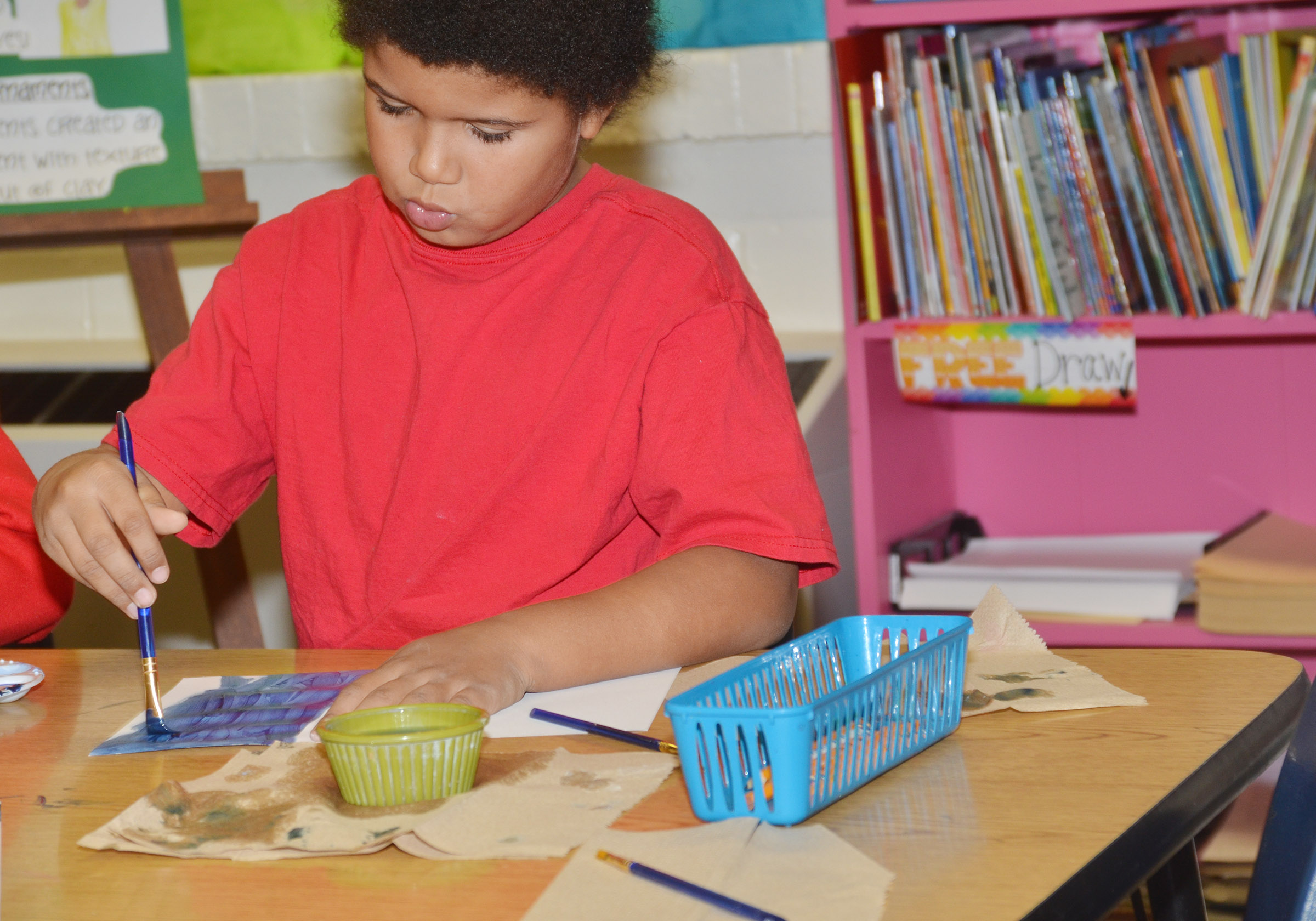 CES second-grader Navon Copeland paints.