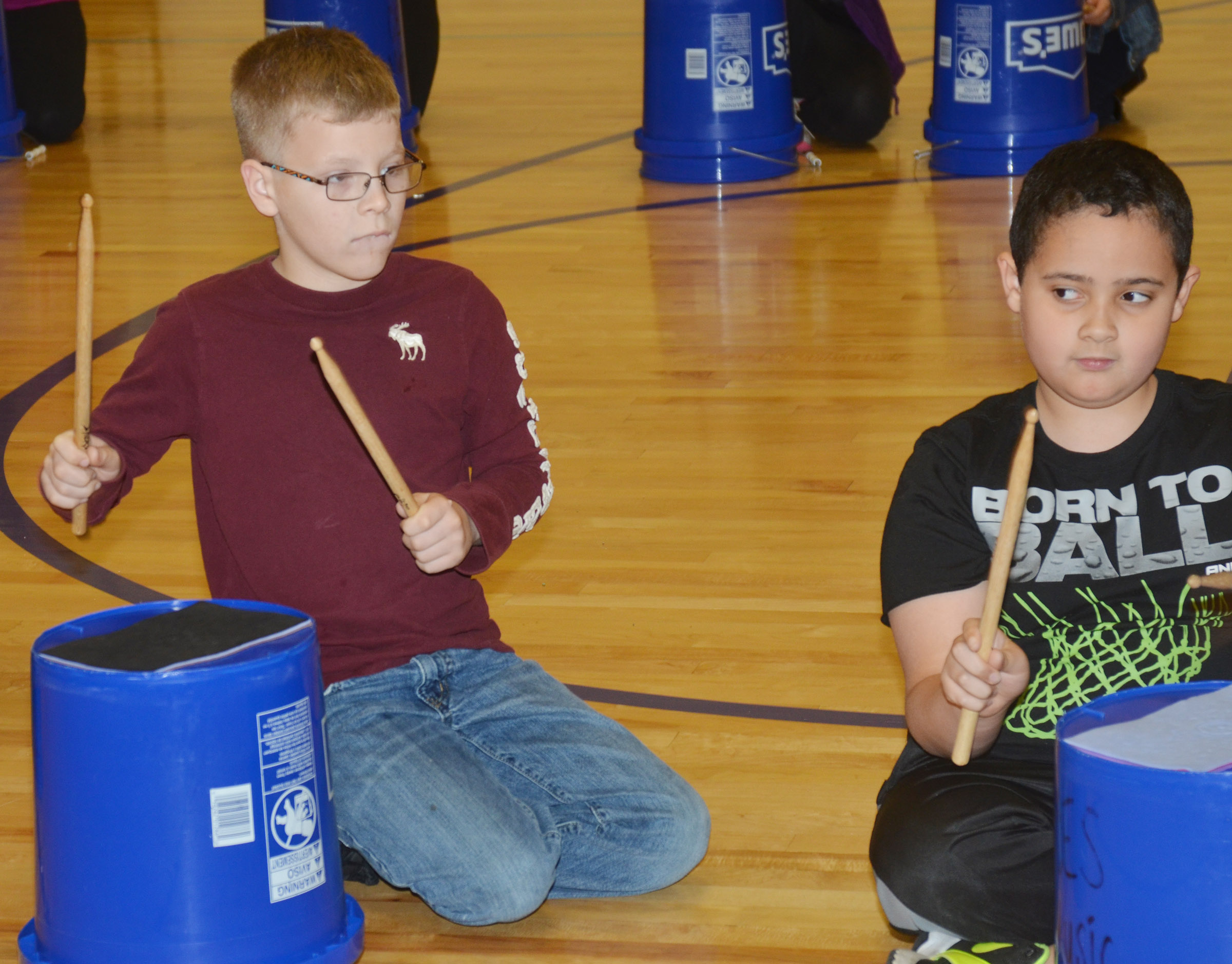 CES fourth-graders Ethan Irwin, at left, and Tayshaun Hickman play the bucket drums.