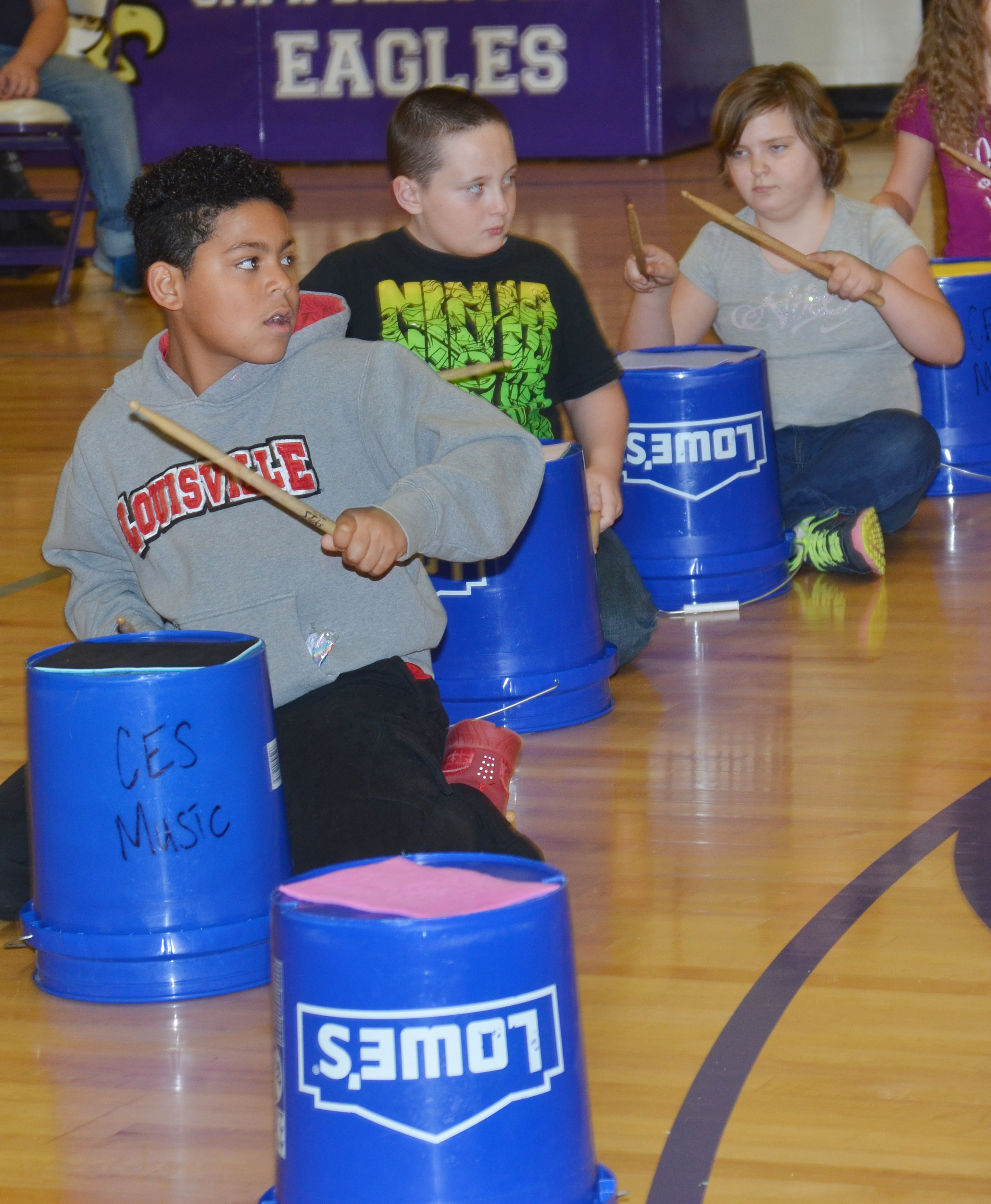 CES fourth-grader Bryson Groves plays the bucket drums.