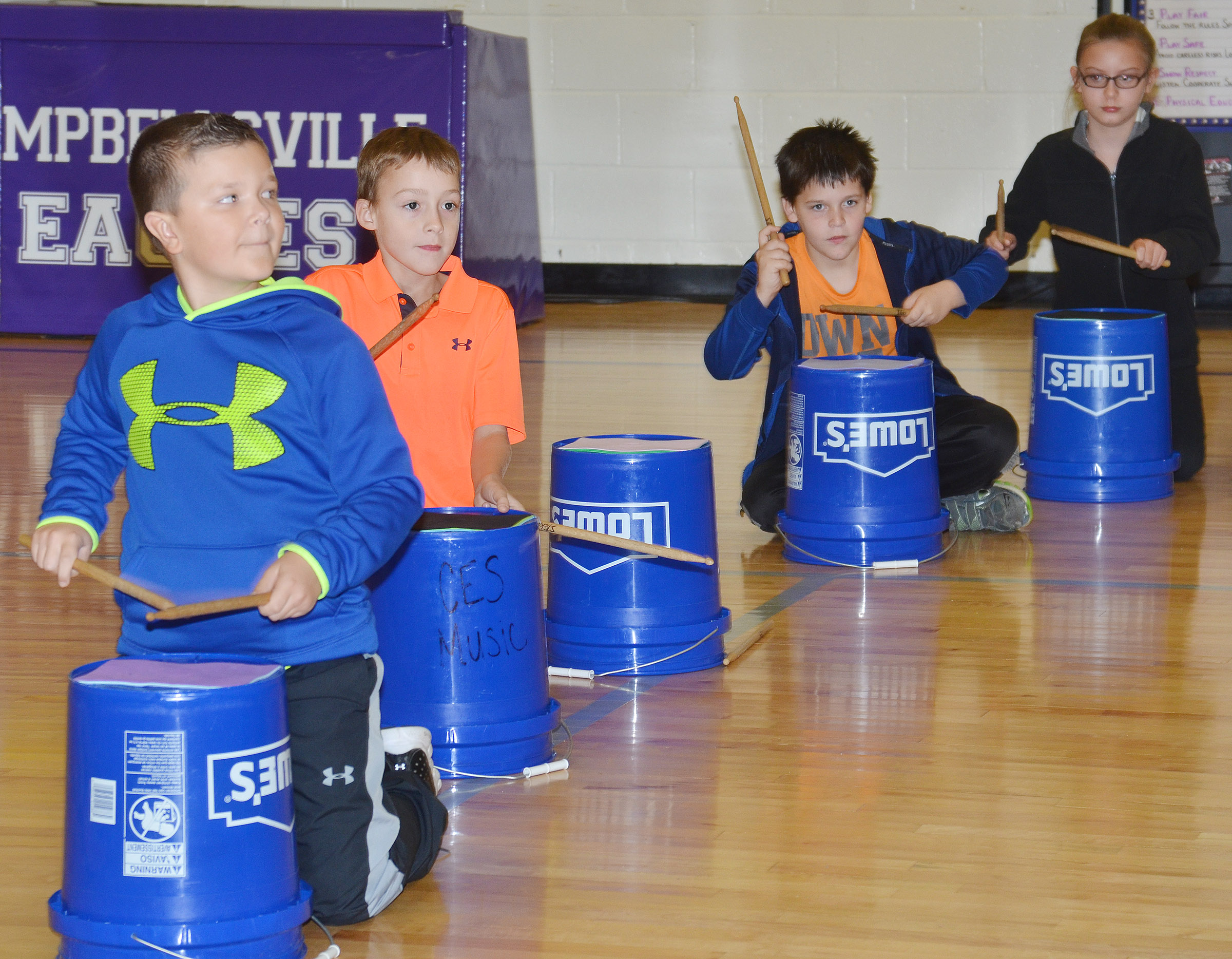 From left, CES third-grader Cayton Lawhorn and fourth-graders Caysen Tungate, Chris Brown and Vivian York play the bucket drums.