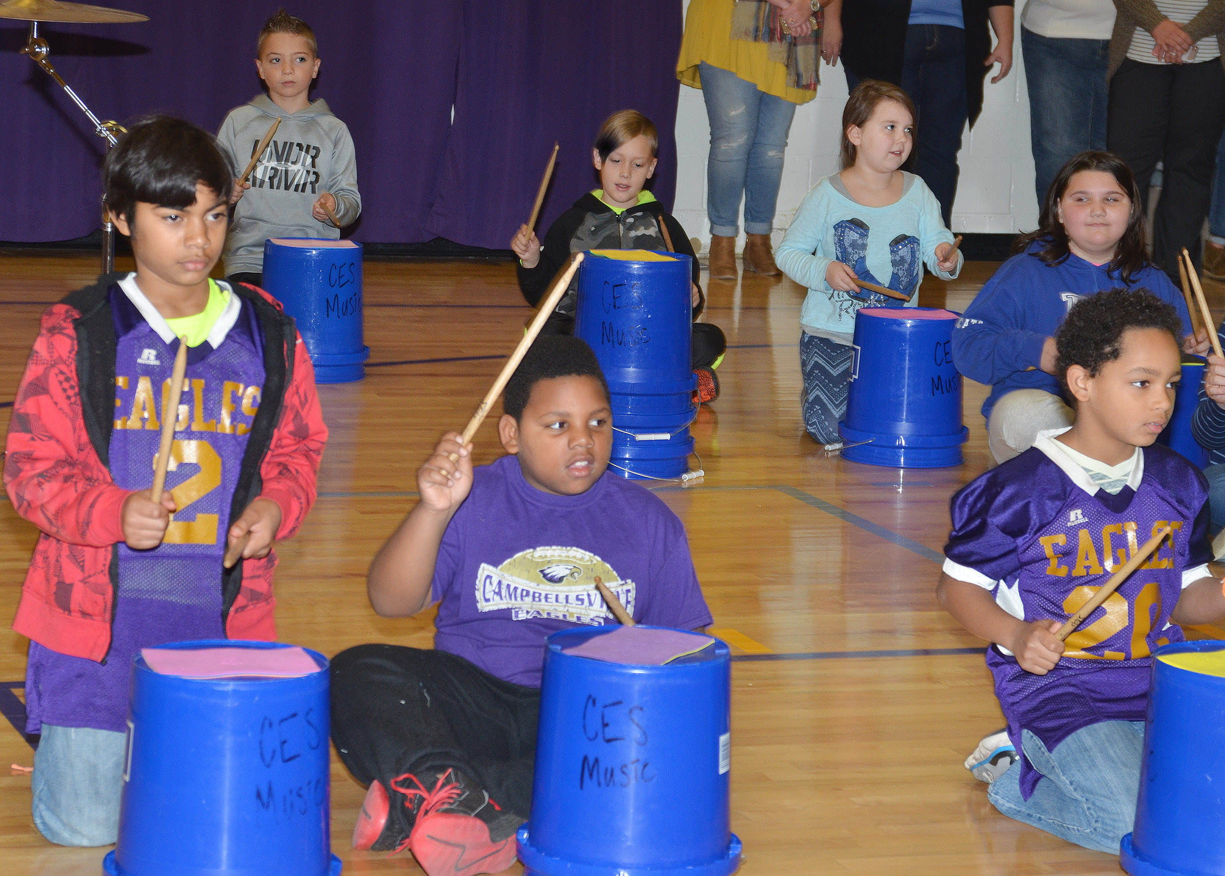 From left, CES fourth-graders LaDainien Smith, Malikiah Spurling and Jalen Embry play the bucket drums.