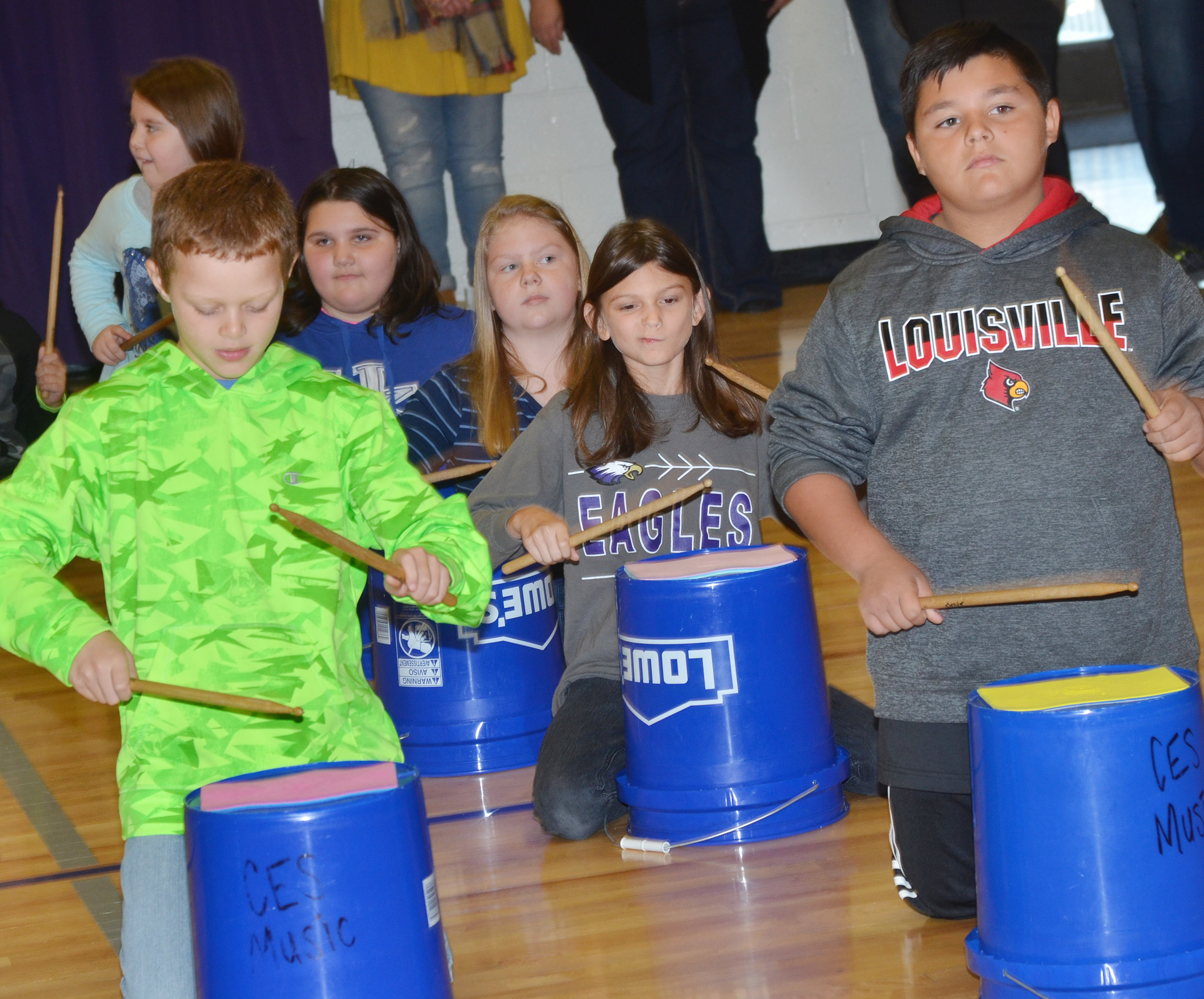 CES fourth-graders Demetrious Dickens, at left, and Brayden Paiz play the bucket drums.