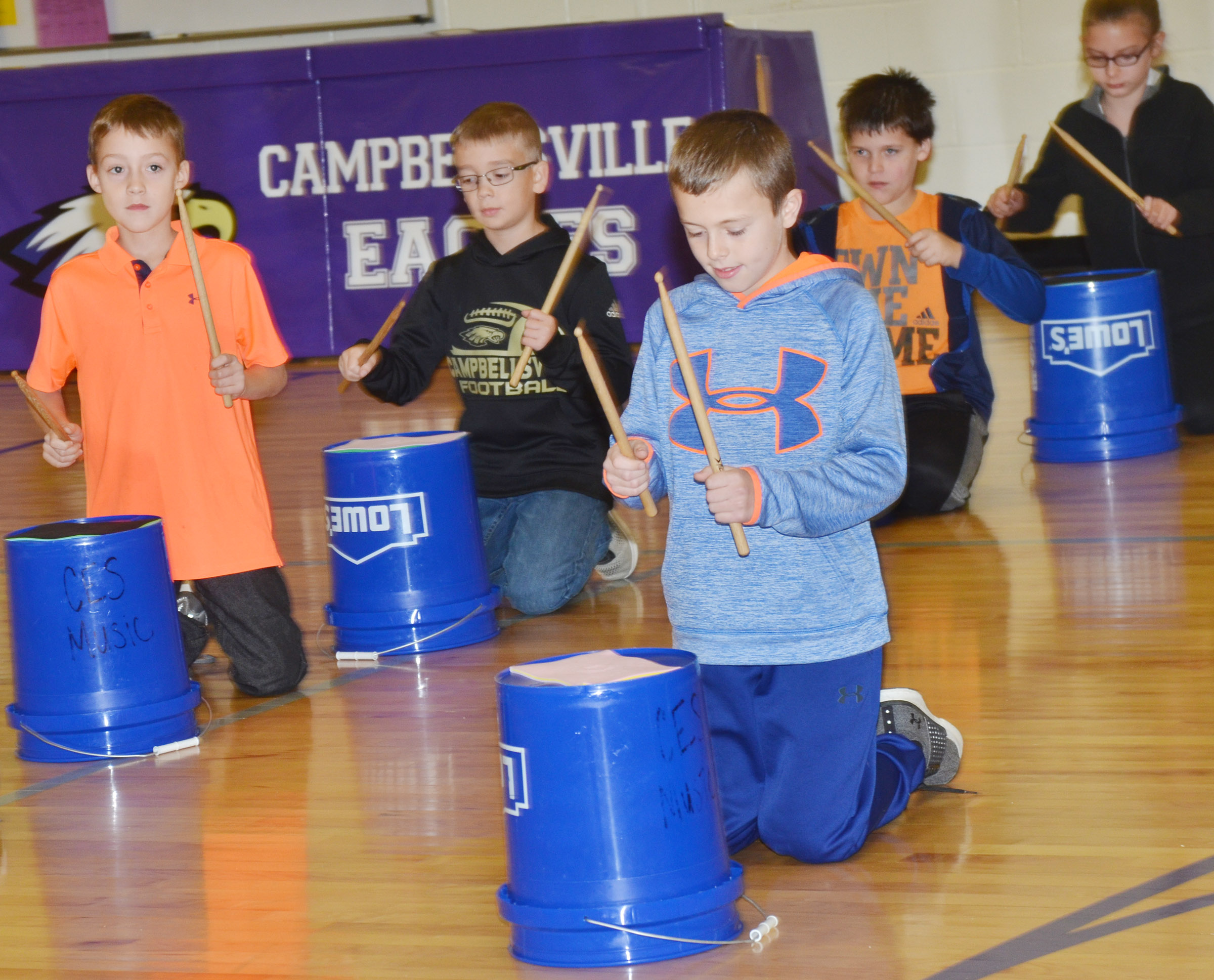 CES fourth-grader Keaton Hord plays the bucket drums.