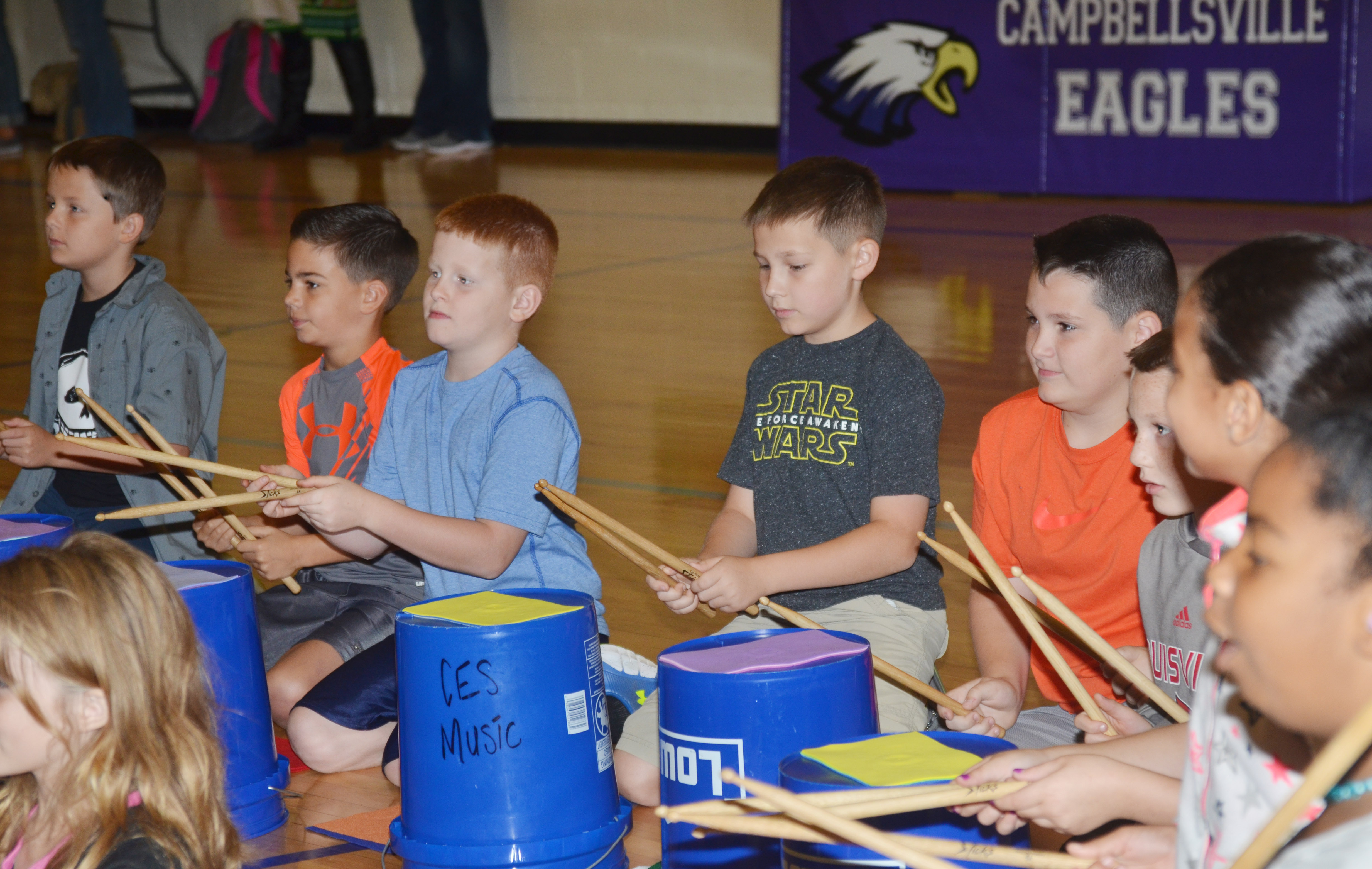 CES fourth-graders perform the Cha Cha Slide on the bucket drums.