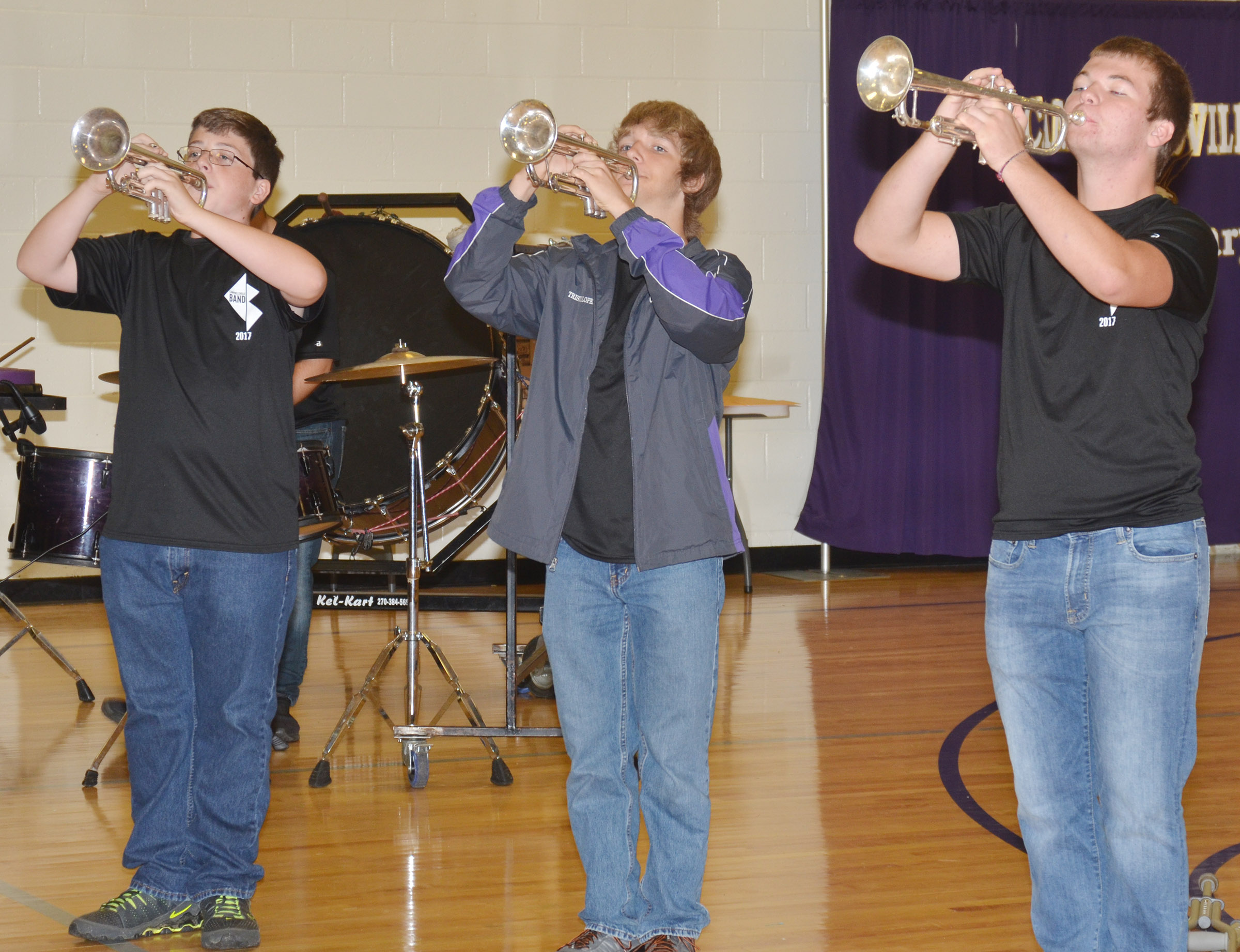 From left, CHS sophomores Gavin Ford and Tristin Lopez and junior Josh Dooley play for CES students.