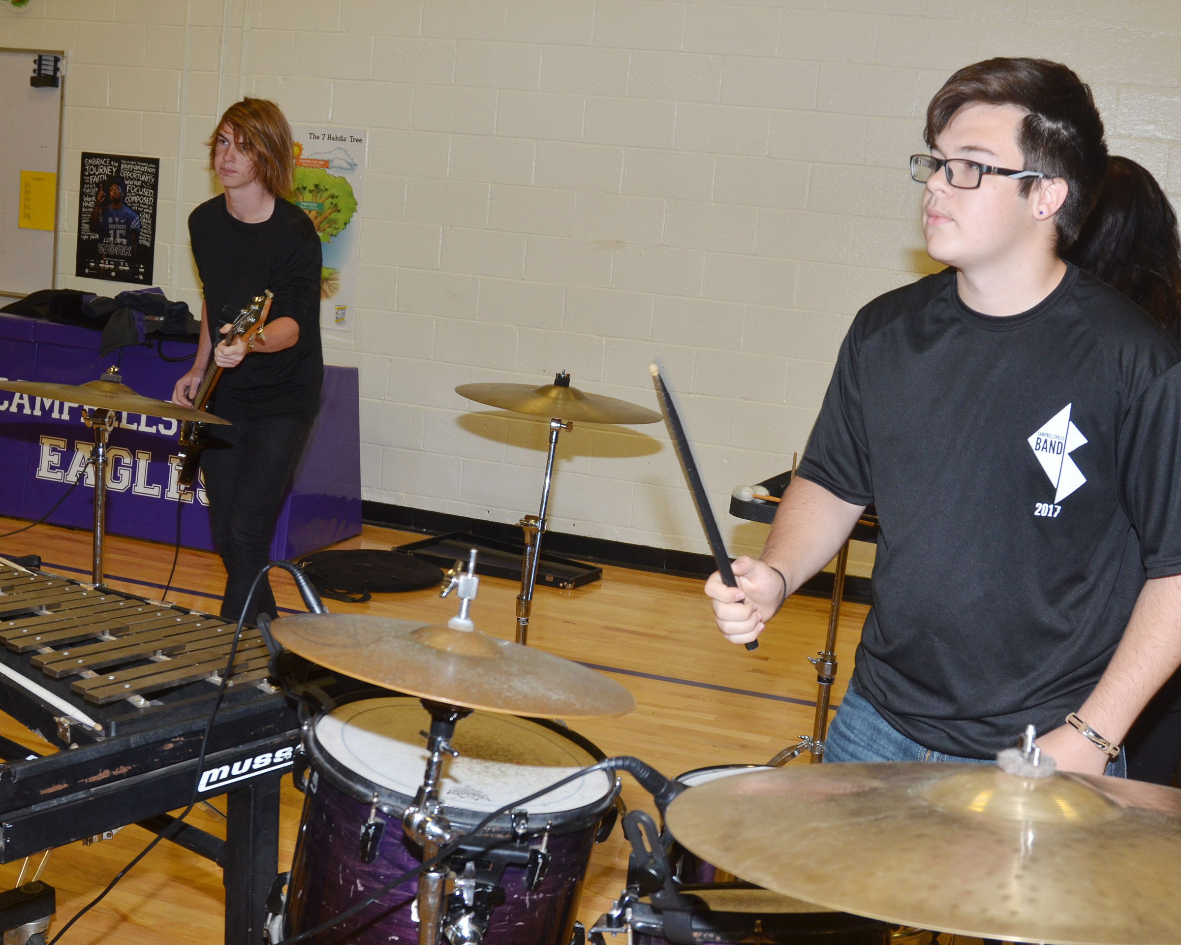 CHS juniors Jason Agee, at left, and Kyler Rakes perform for CES students.