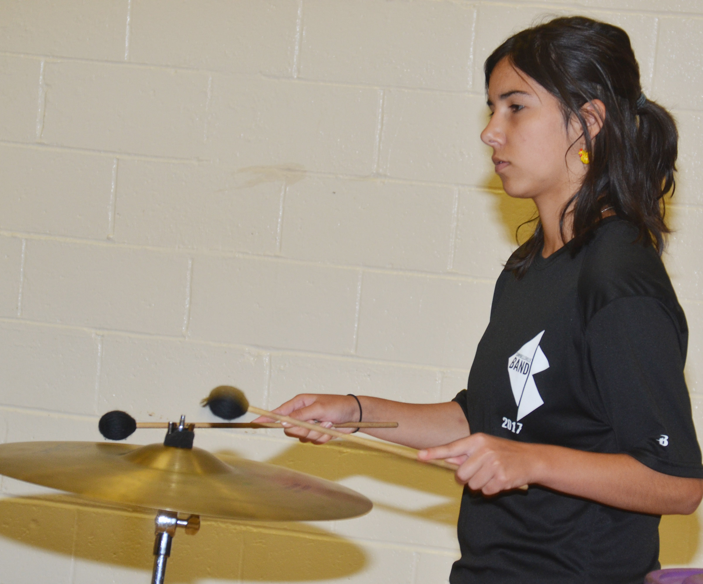CHS junior Celeste Hassman performs for CES students.