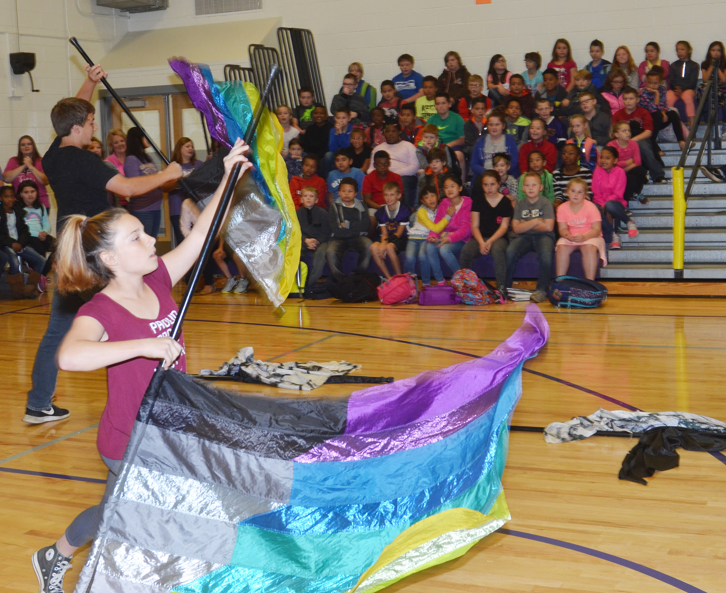 CES freshman Nick Drew, at left, and Campbellsville Middle School seventh-grader Alyssa Orberson perform for CES students.