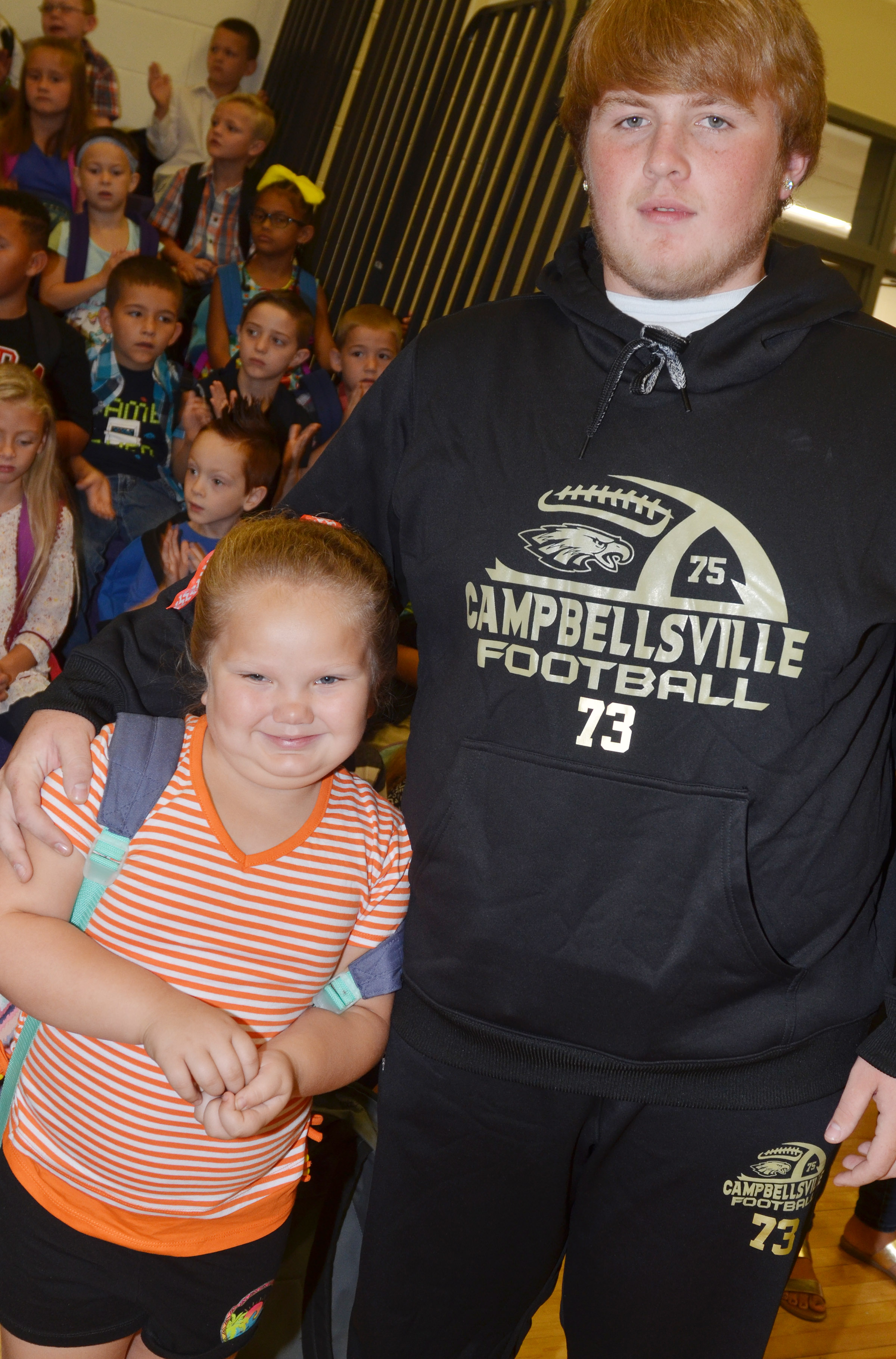 CHS senior Ryan Jeffries poses for a photo with his sister, ReAnna, a first-grader at CES.