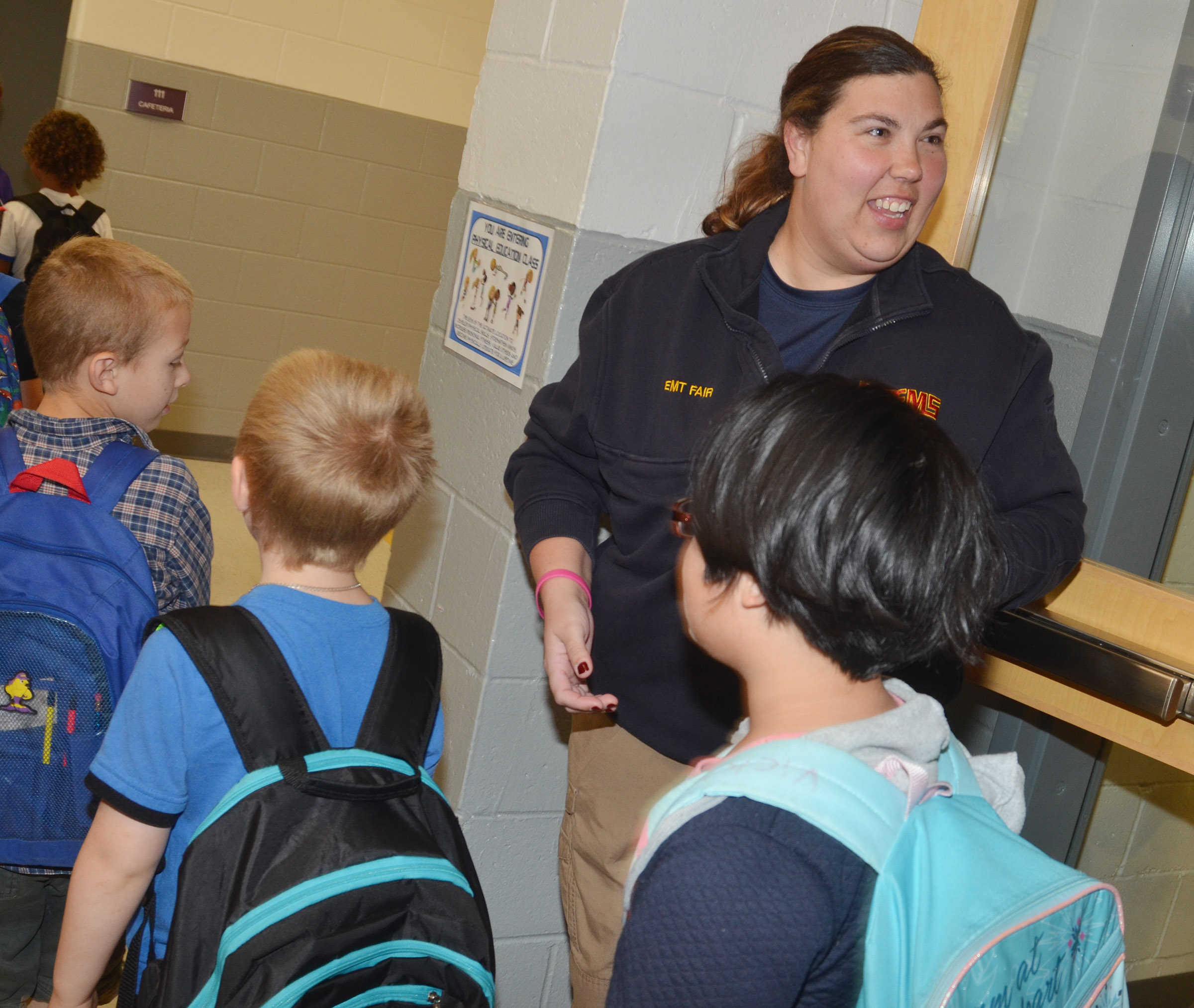 Jackie Fair, an EMT with Campbellsville/Taylor County EMS, greets CES students.