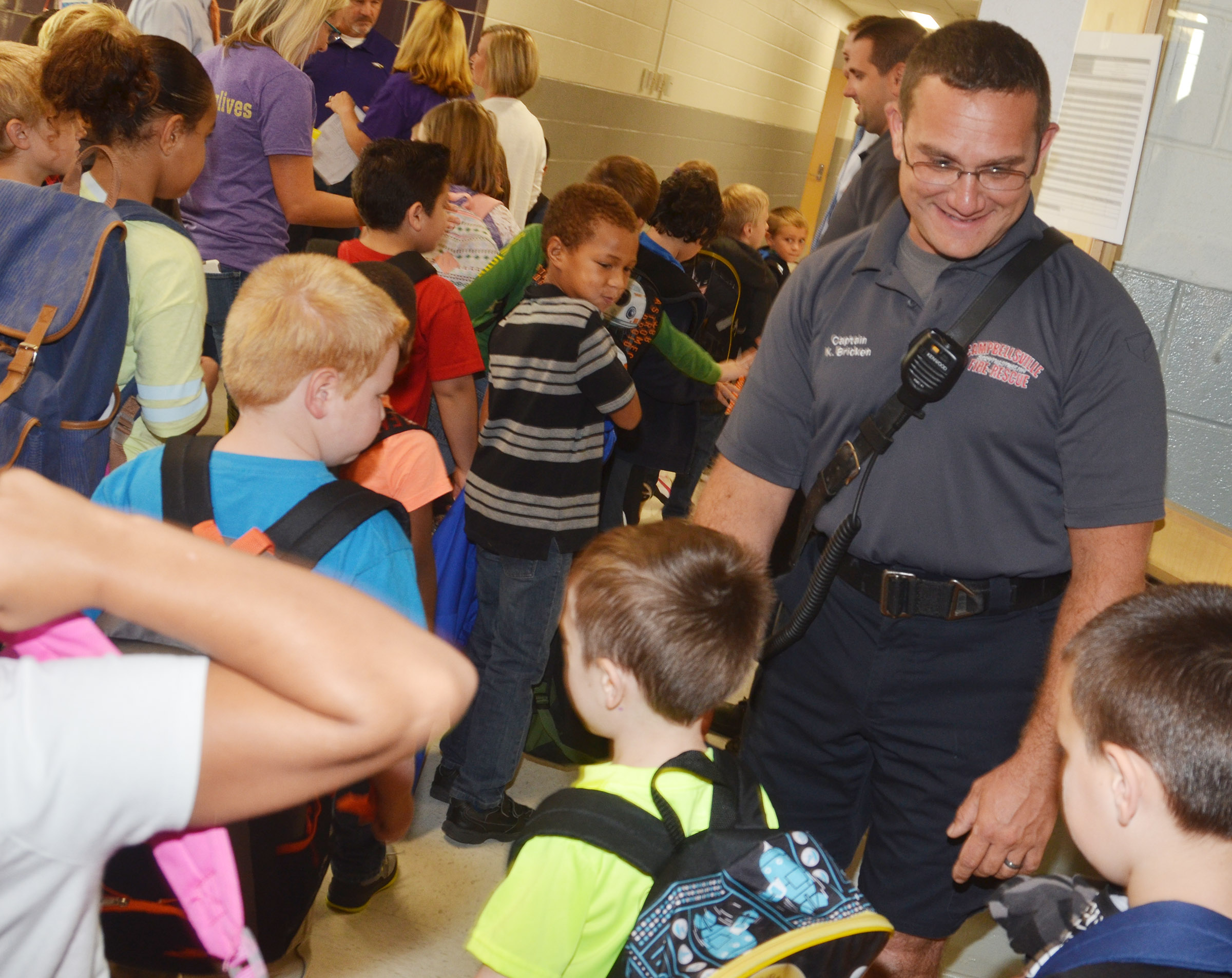 Campbellsville Fire & Rescue Captain Keith Bricken greets CES students.