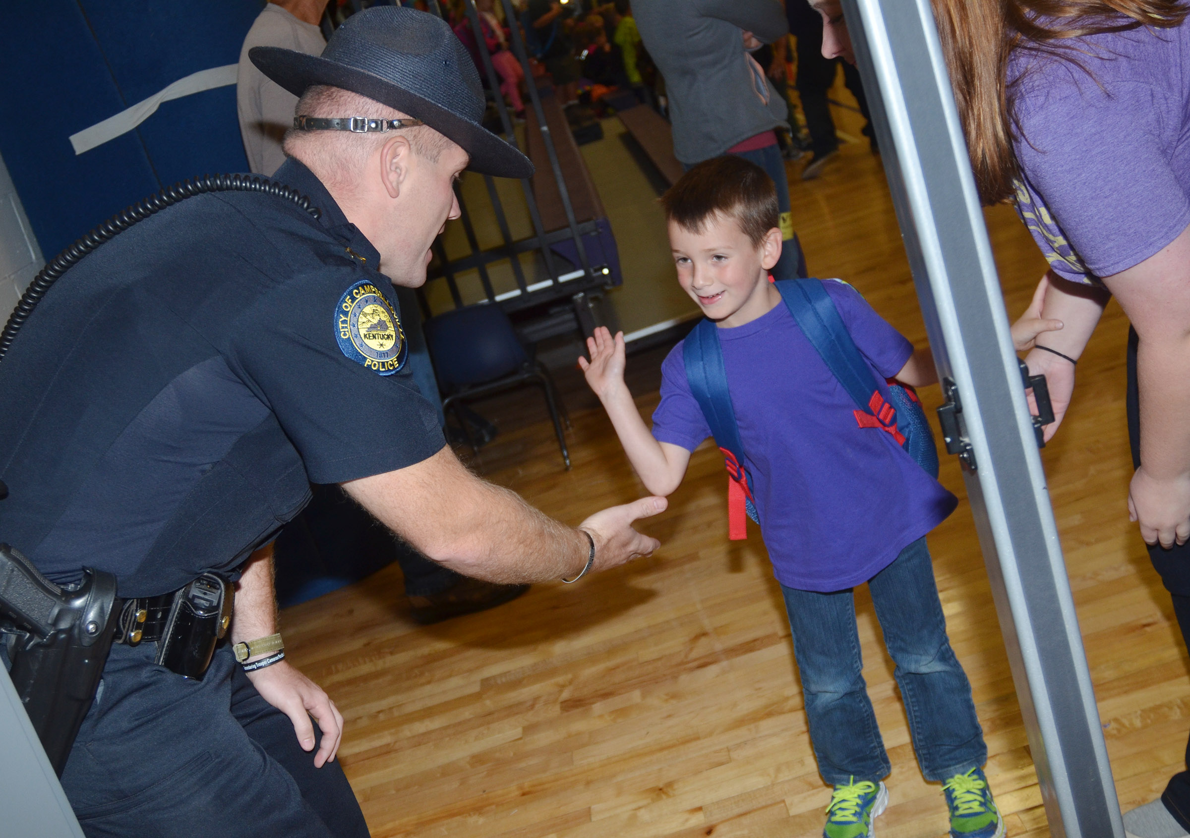 Campbellsville Police Officer Jake Hedgespeth greets kindergartener Cash Davis, who says he wants to be a police officer when he gets older.