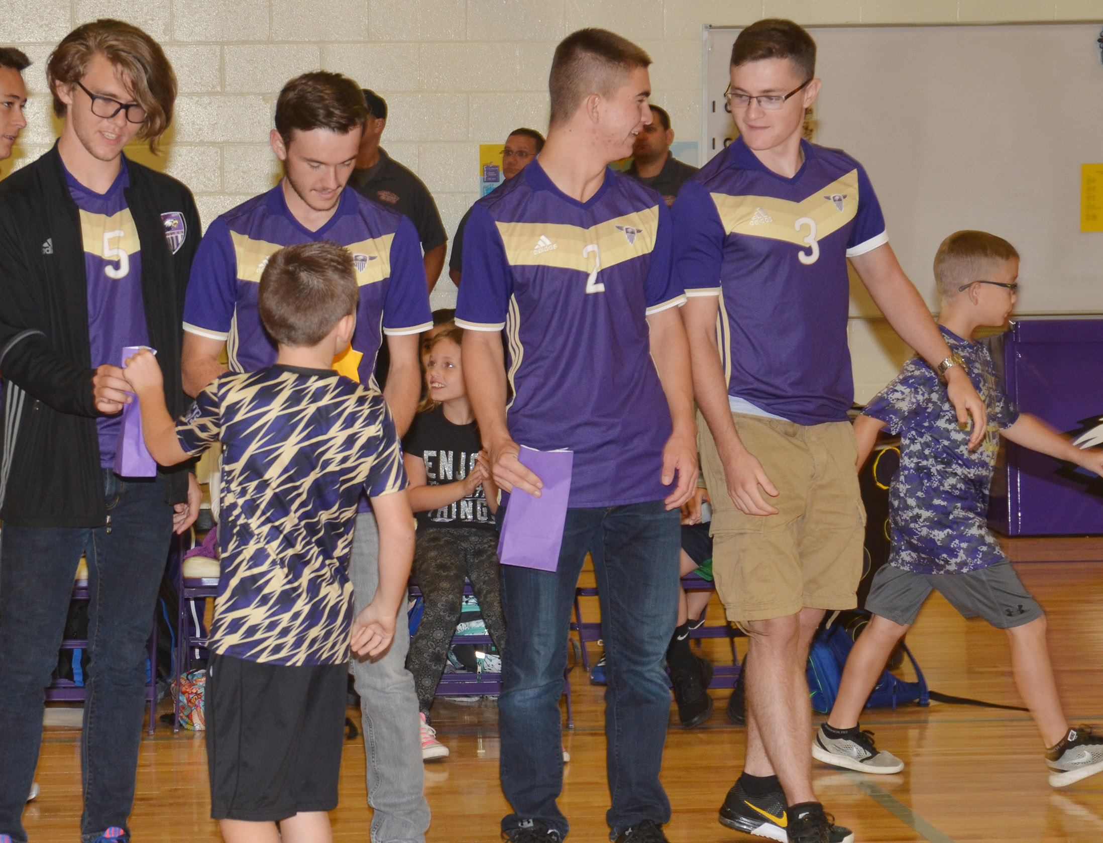 CES students honor CHS soccer players. From left are seniors Christian Berry, Jackson Hunt, Cass Kidwell and Bryce Richardson.